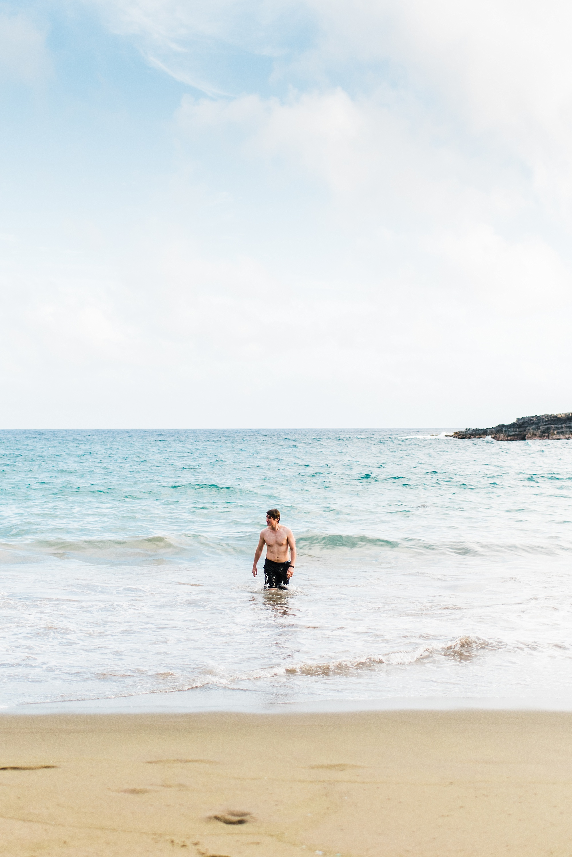 Photo of Devon Young, co owner of Forthright Photo, on Papakolea Green Sand Beach on the Island of Hawaii
