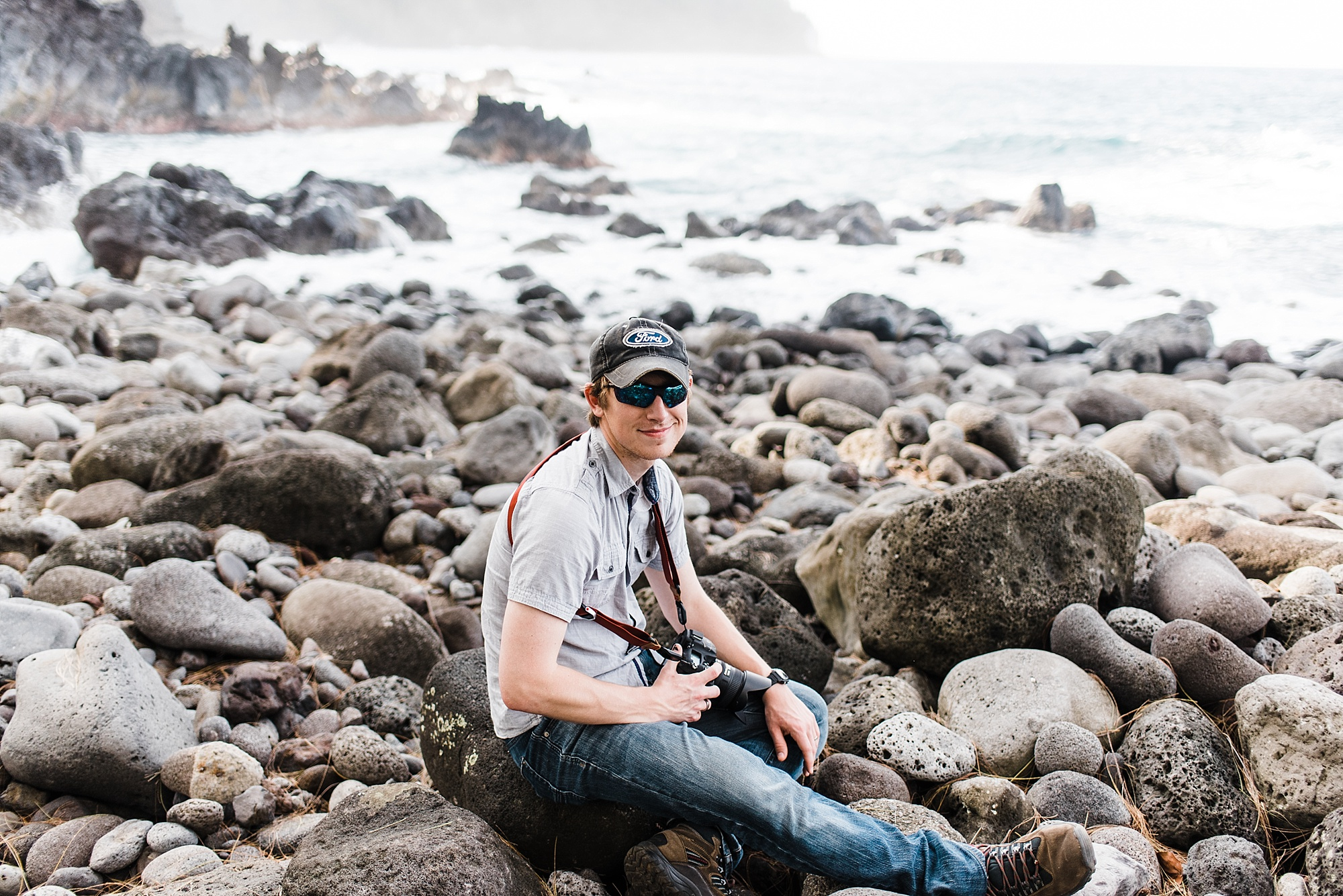 Photo of Devon Young of Forthright Photo on Laupahoehoe Beach taken by Laura Lango of Forthright Photo