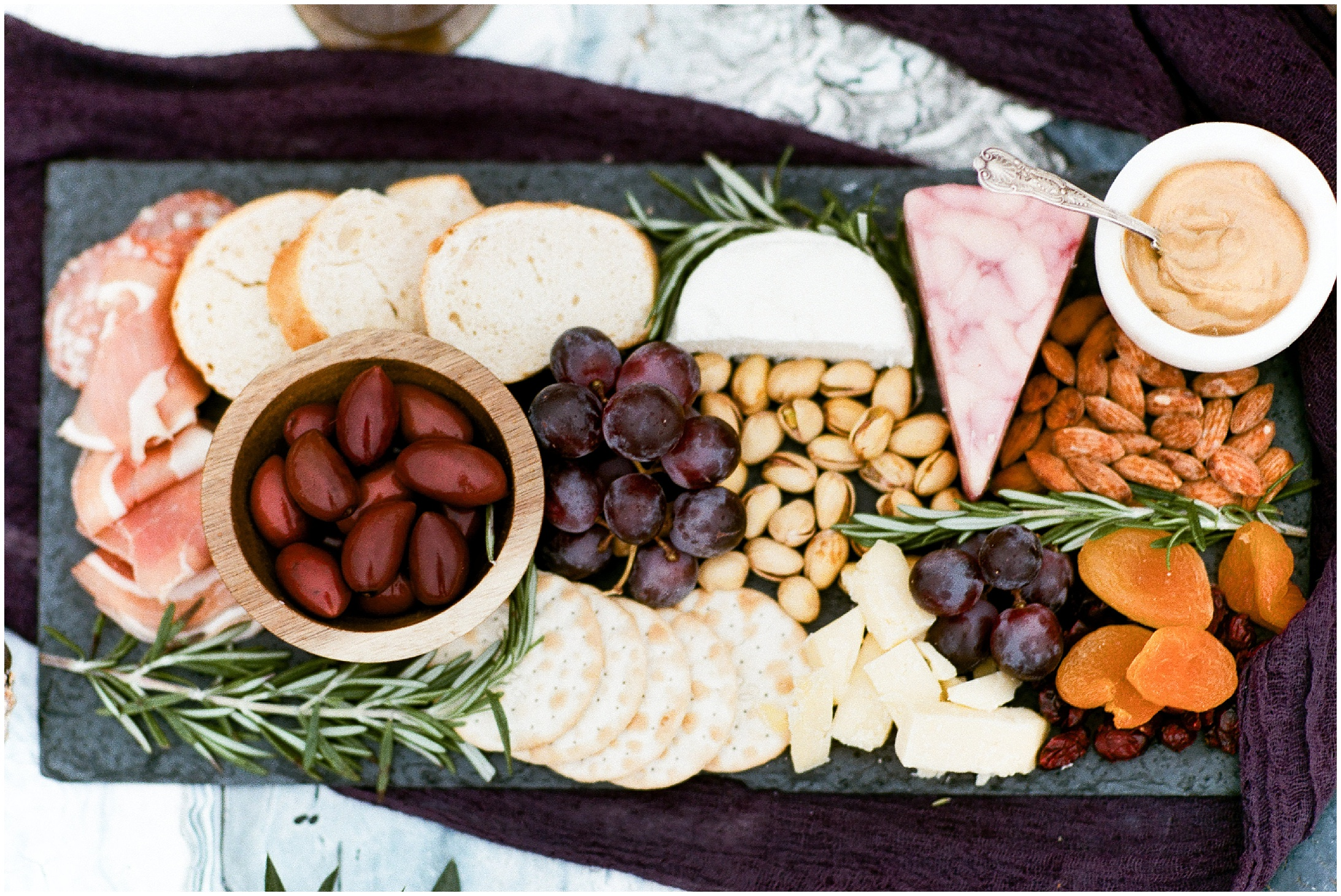 A close up photo of a charcuterie board. Elopement dinner and snack ideas. Image by Forthright Photo