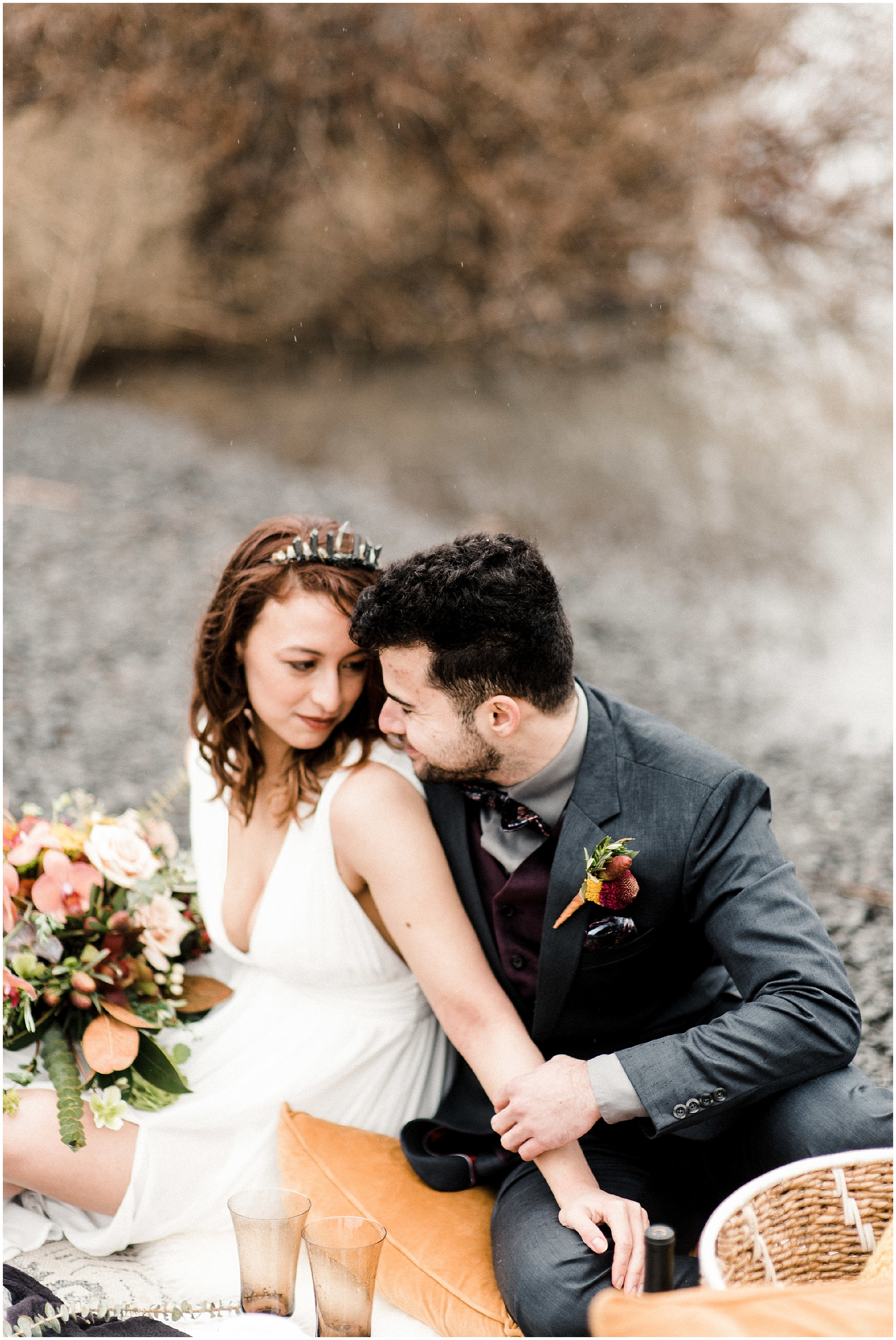 Photo of a bride and groom sitting by the river in a styled elopement shoot in Lyons Ferry State Park by Forthright Photo