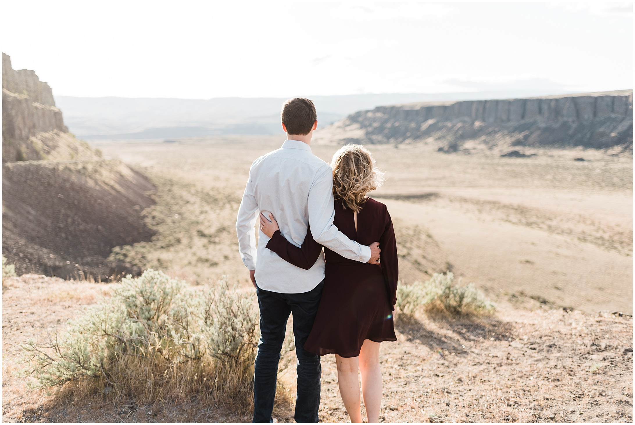 Photo of a couple standing alongside a desert canyon edge in Vantage WA by Forthright Photo