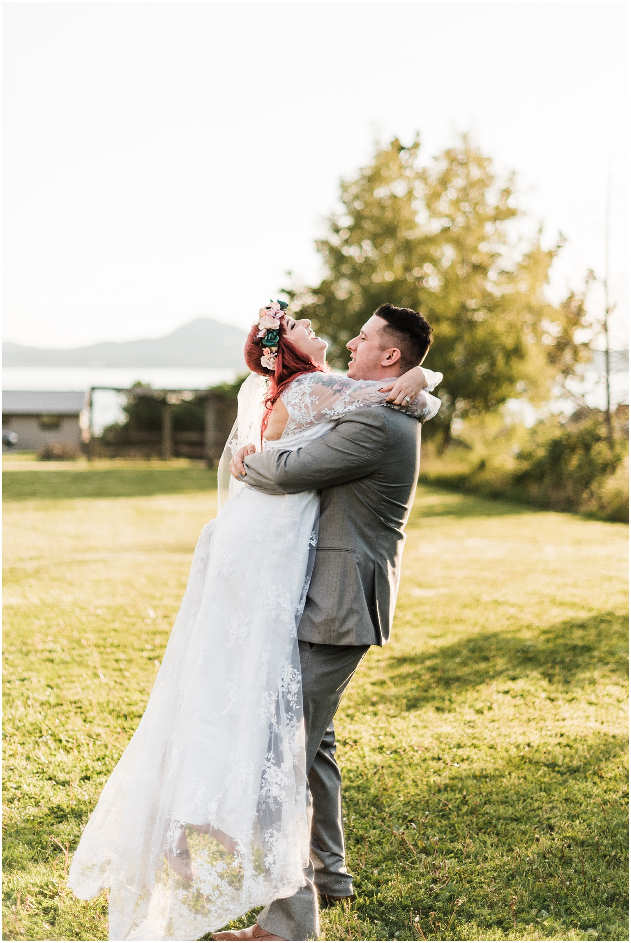 Photo of bride and groom dancing on the lawn of Bayview Civic Hall during their wedding reception in Bayview, WA