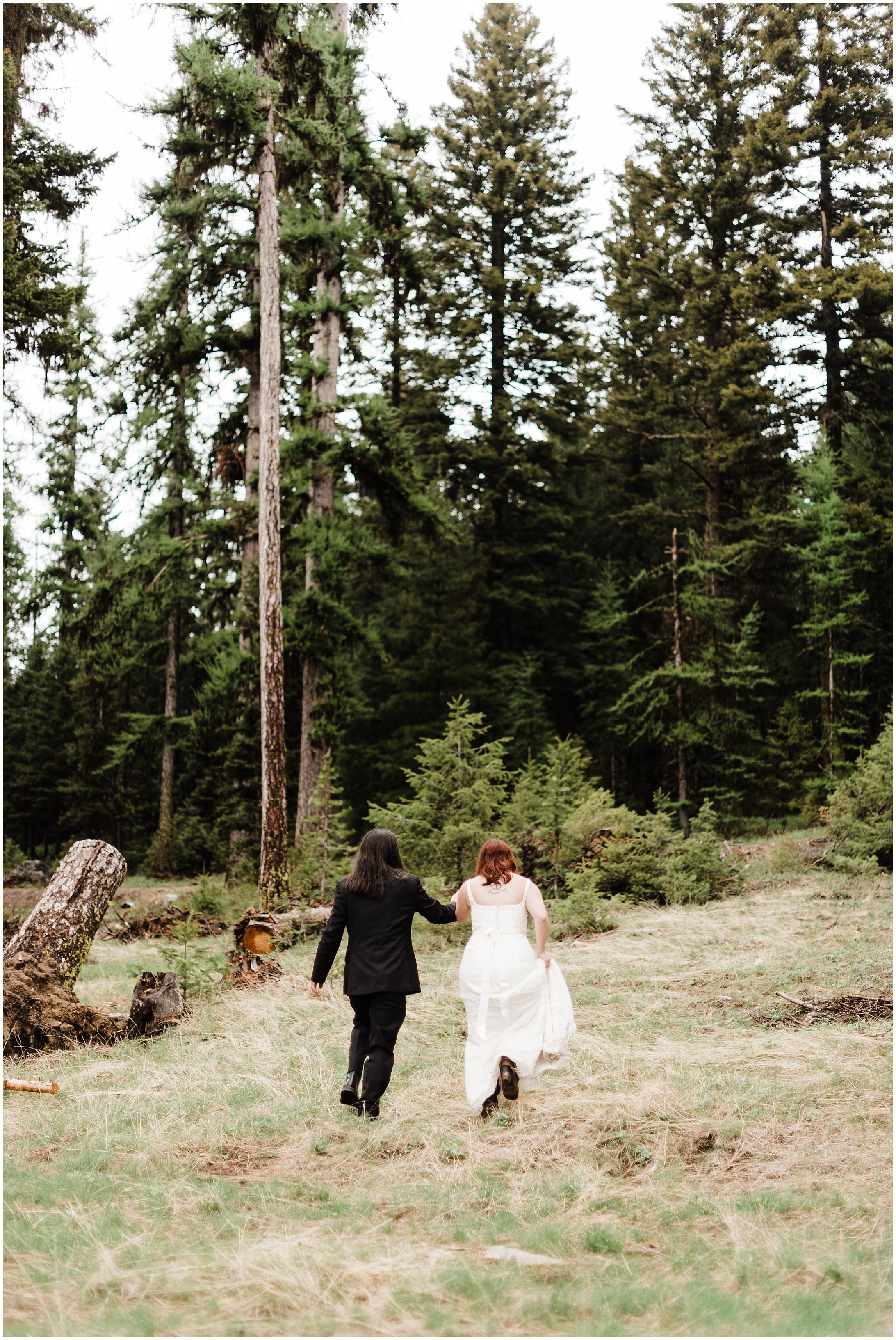 Bride and Groom running through a forest outside of Omak, WA by forthright photo
