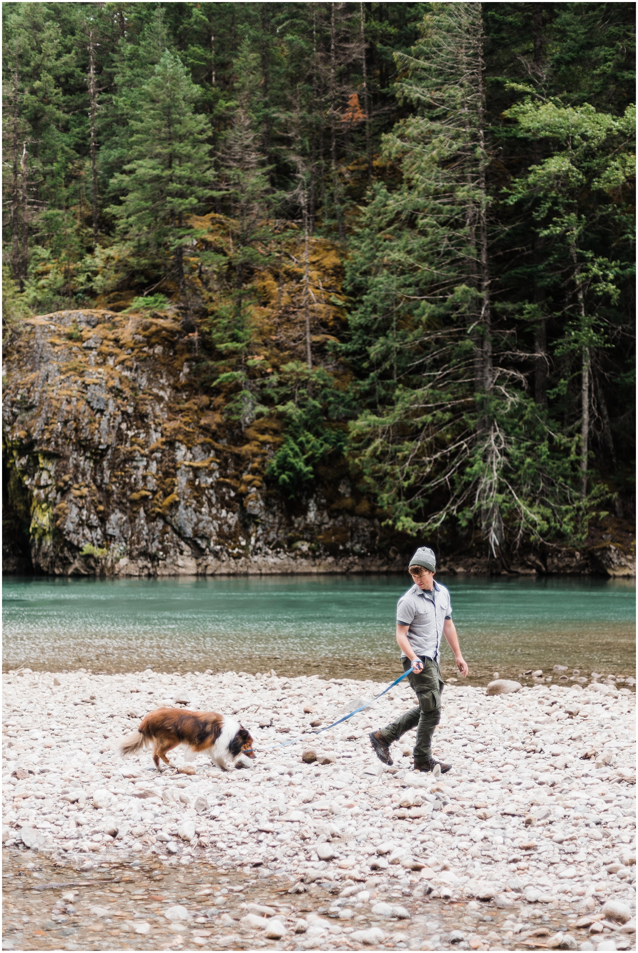 Photo of Devon walking our dog Simon along the banks of a river in North Cascades National Park by Forthright Photo