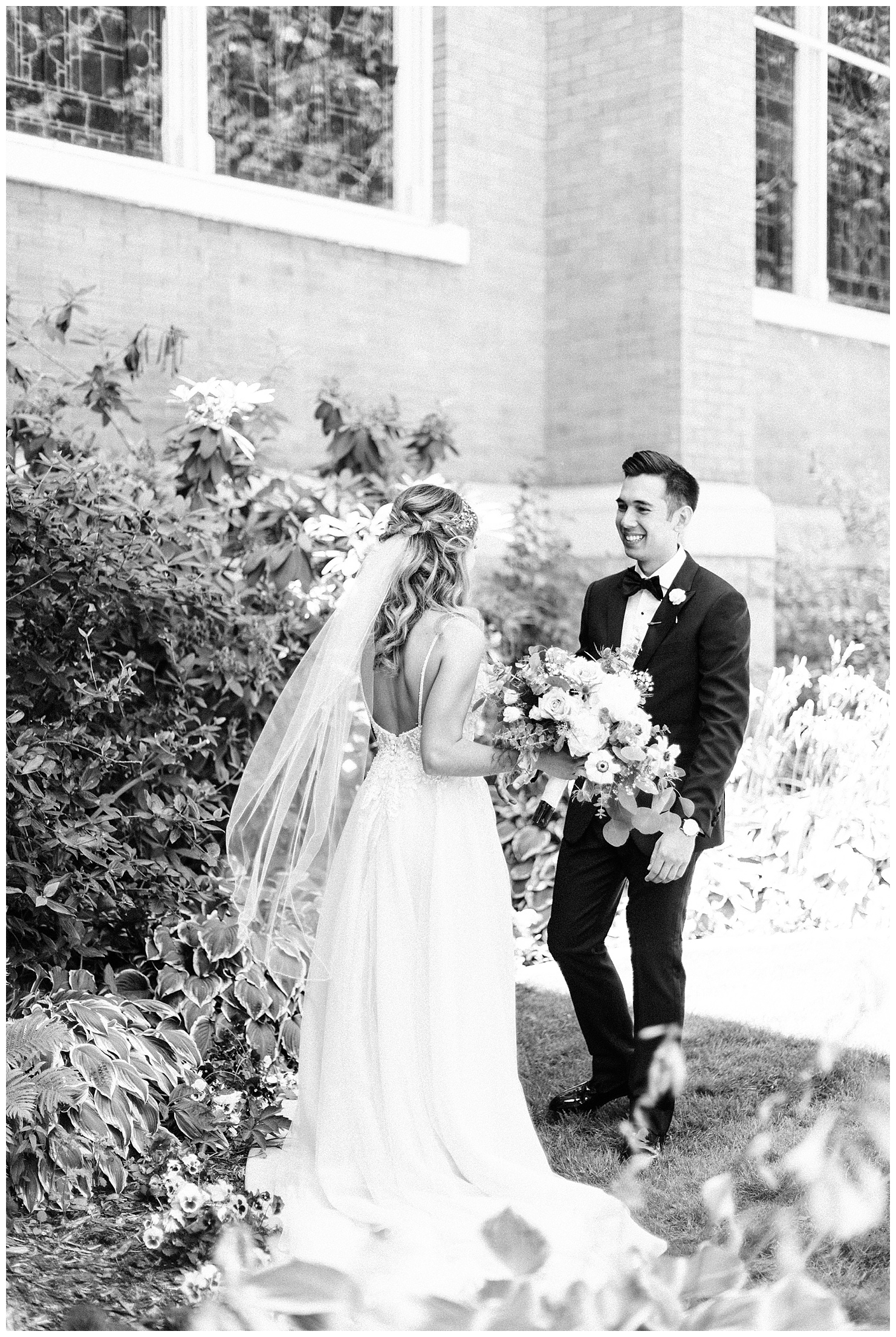 Black and White photo of a bride & groom at their first look on the lawn of St. Aloyius Cathedral in Spokane, WA by Forthright Photo