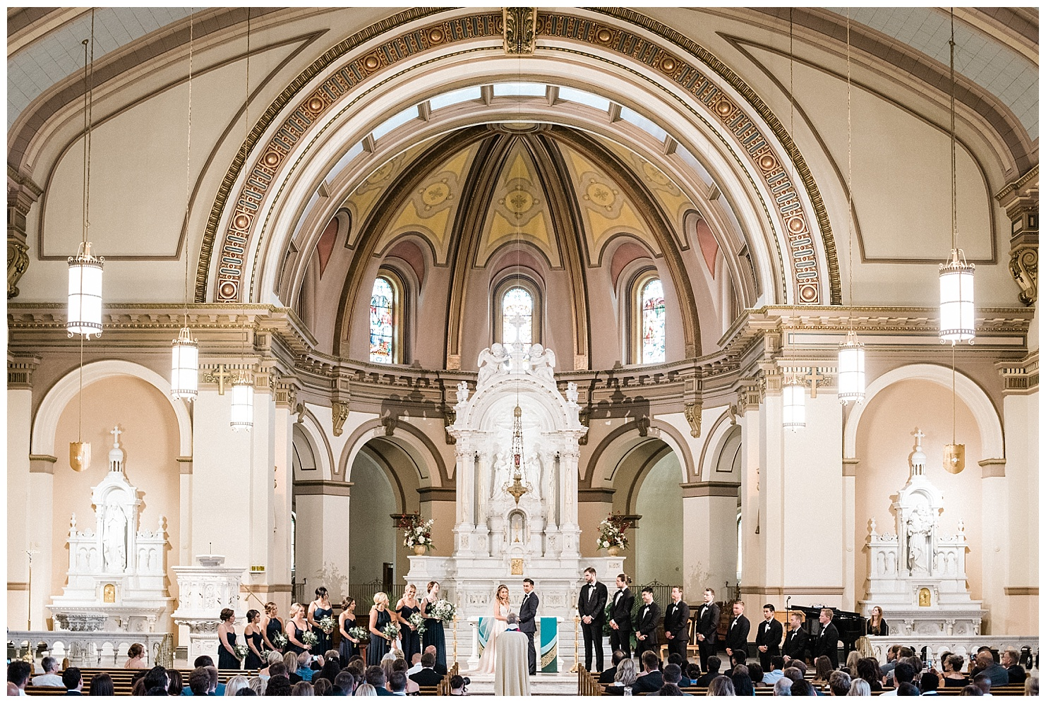 Photo of a wedding ceremony in St. Aloyius Cathedral by Forthright Photo