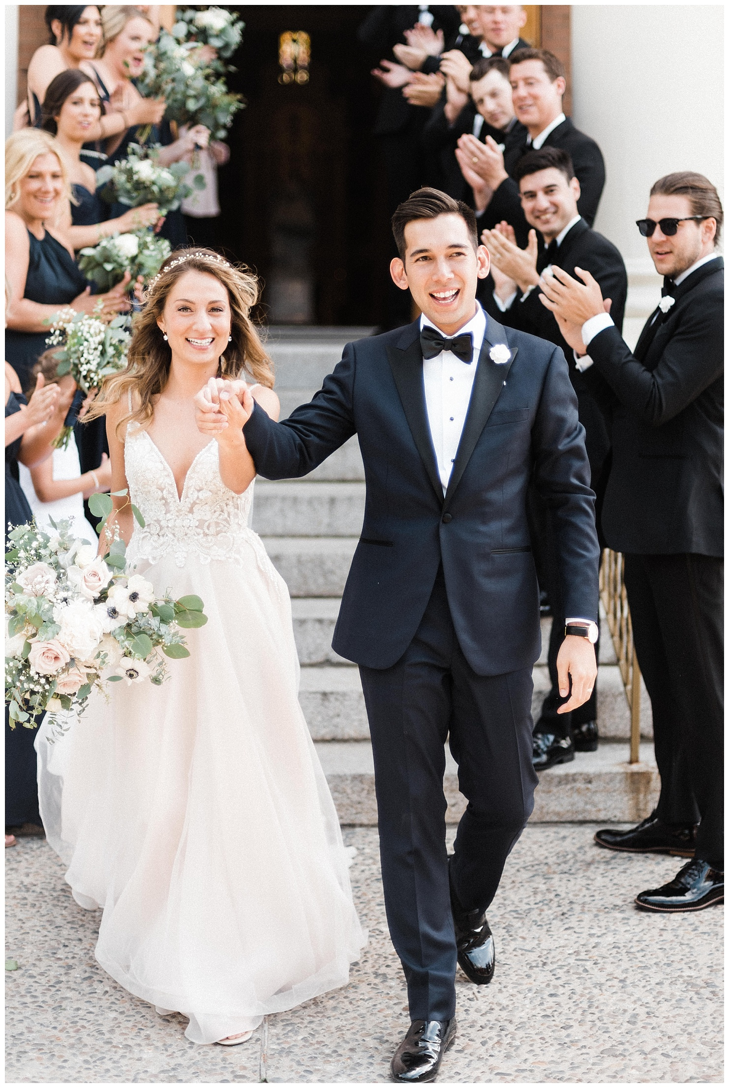 Photo of a bride & groom exiting their wedding ceremony at St. Aloyius Cathedral by Forthright Photo