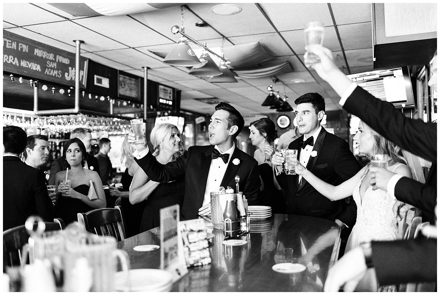 Photo of a wedding party at Jack & Dan's bar in Spokane, Washington by Forthright Photo