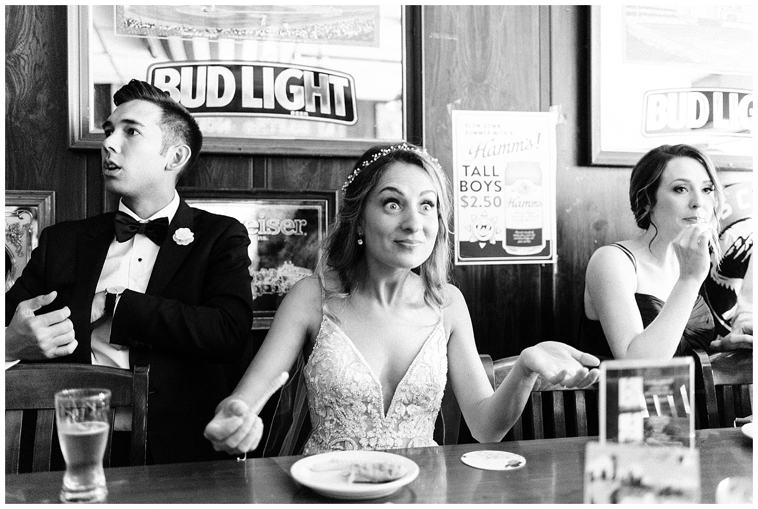 Photo of a bride & groom eating french fries at Jack & Dan's bar in Spokane, Washington by Forthright Photo