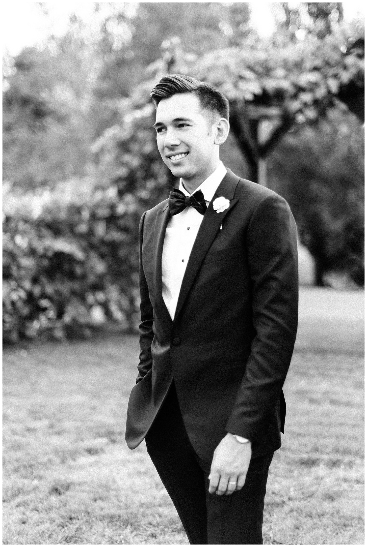 Black and white portrait of a groom at his Beacon Hill wedding reception in Spokane, WA by Forthright Photo