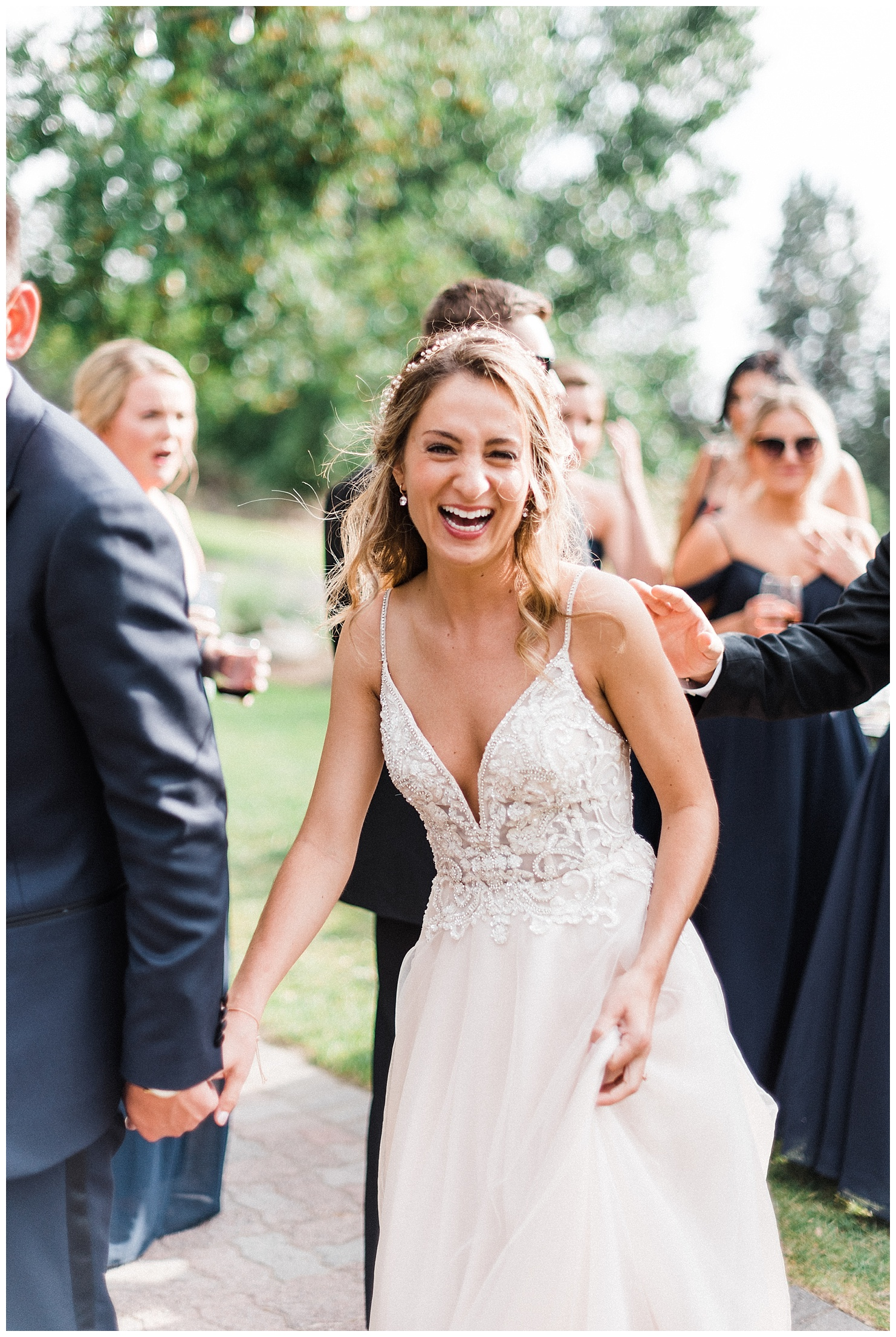 Photo of a bride laughing by Forthright Photo