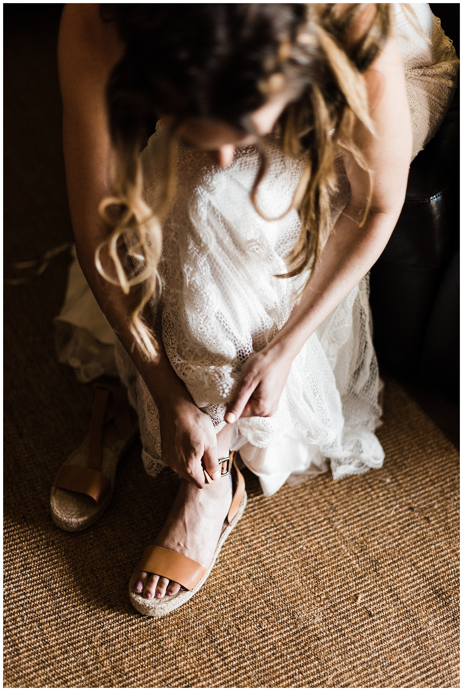 Photo of a bride putting on her shoes by Forthright Photo
