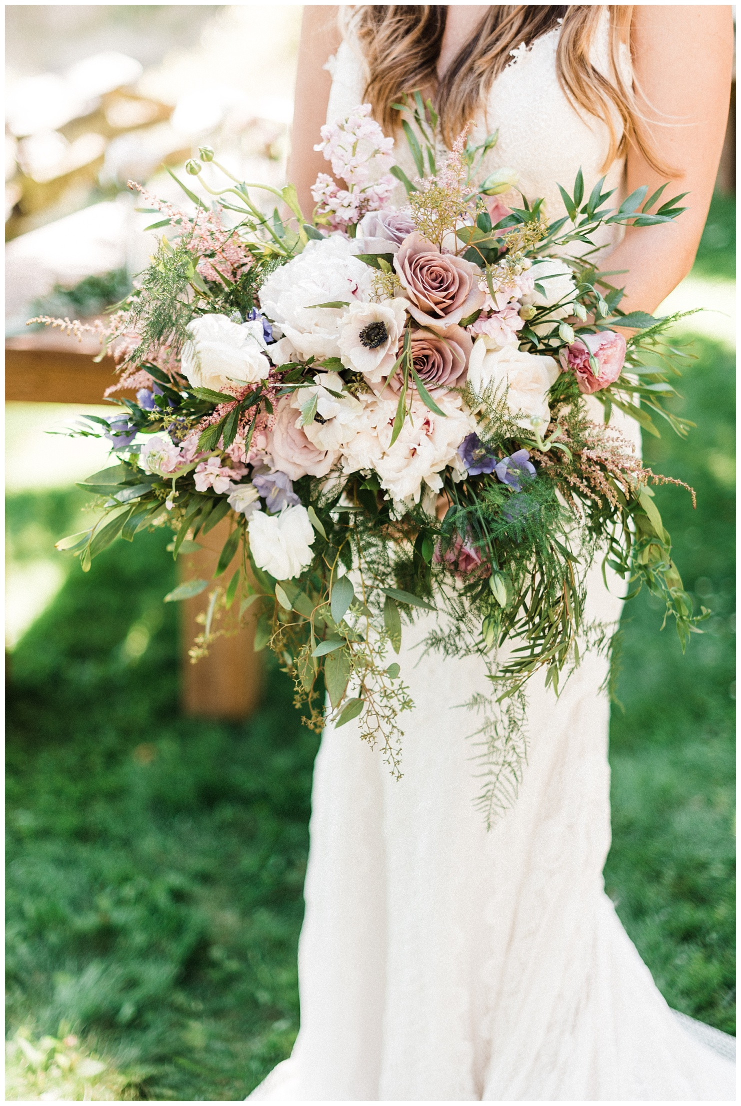 Photo of a bride holding a large bouquet by Forthright Photo