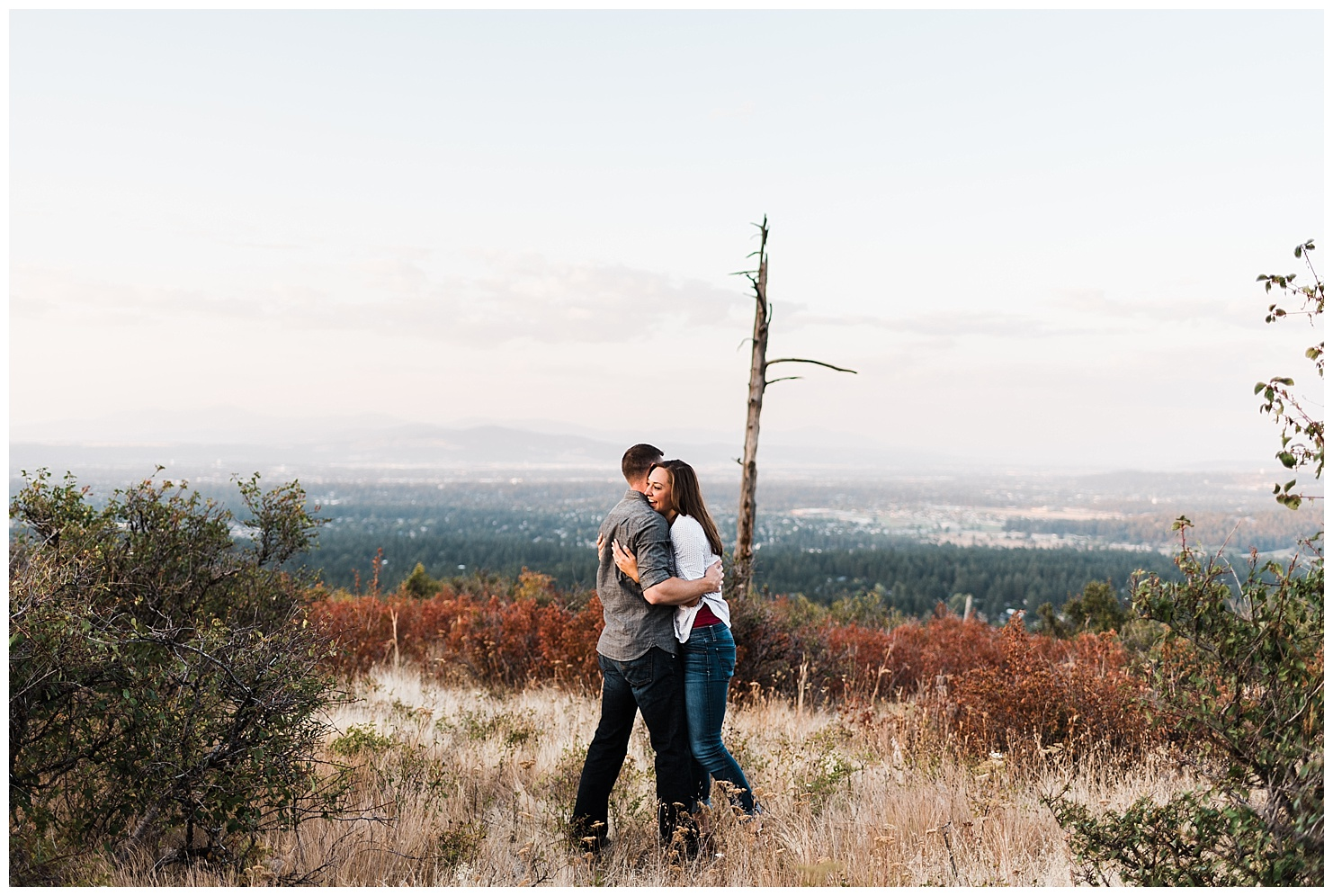 Photo of a couple in Iller Creek Conservation area in Spokane WA at sunset. Taken by Forthright Photo