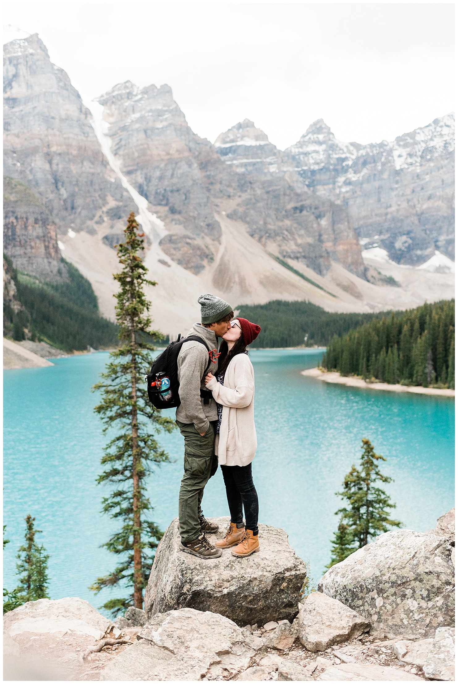 Laura & Devon of Forthright Photo, adventurous wedding photographers, at Lake Moraine in Banff National Park