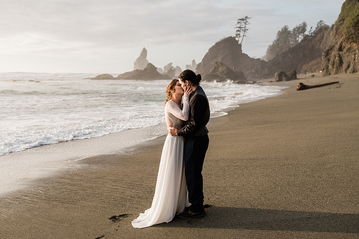 Bride & Groom running along Shi Shi Beach in the Olympic National Forest for this elopement inspiration shoot. Image by Forthright Photo
