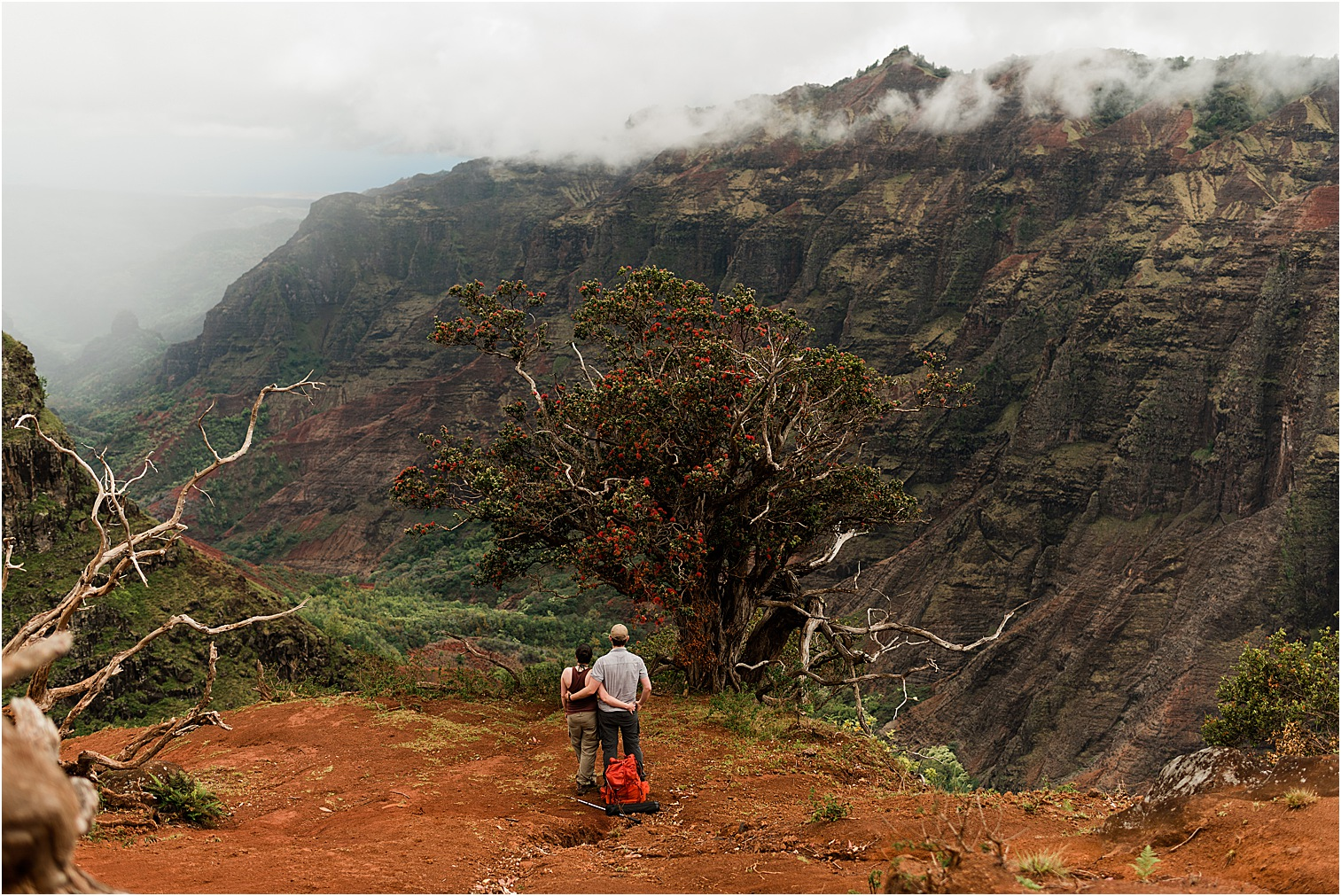 Couple overlooking the Waimea Canyon. Image by Forthright Photo, Kauai Wedding & Elopement Photographers