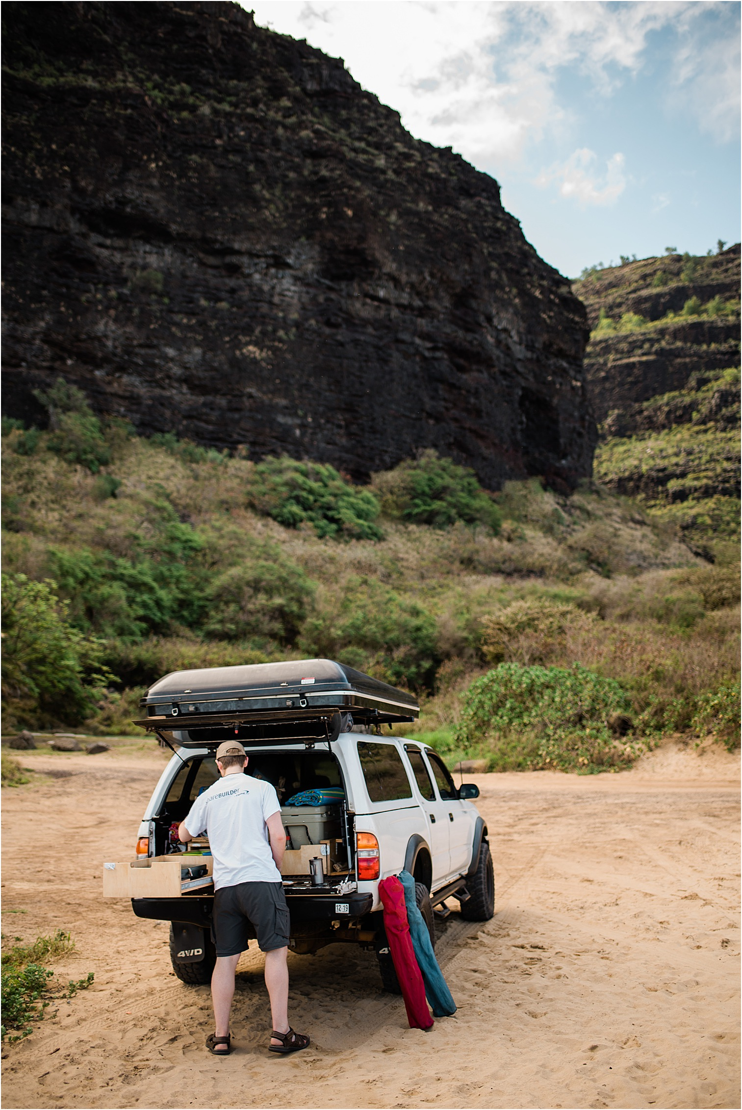 Devon loading up the camper truck from Kauai Overlander at Polihale Beach State Park. Image by Forthright Photo