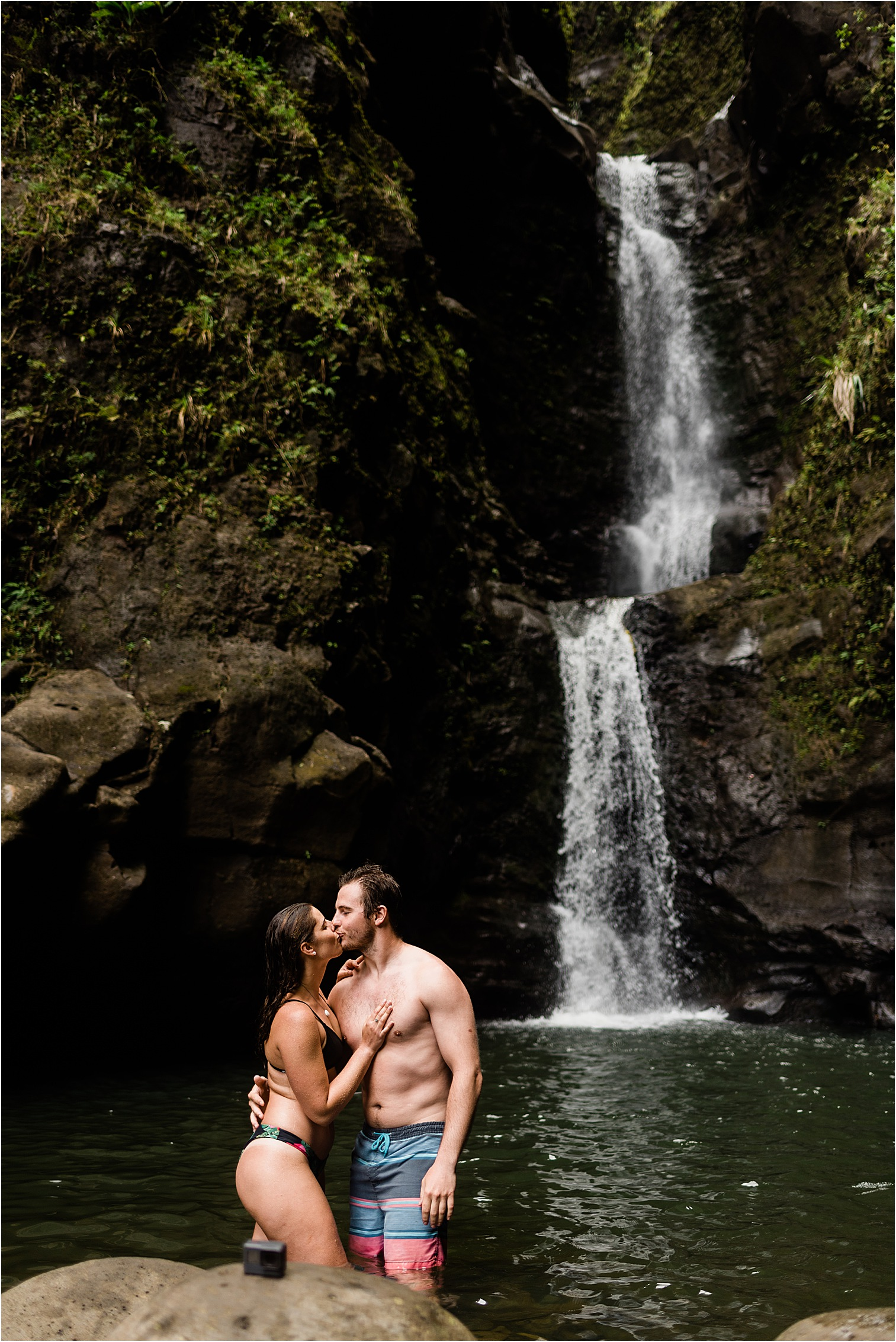 Couple at a waterfall on Kauai. Image by Forthright Photo, Kauai Wedding Photographers