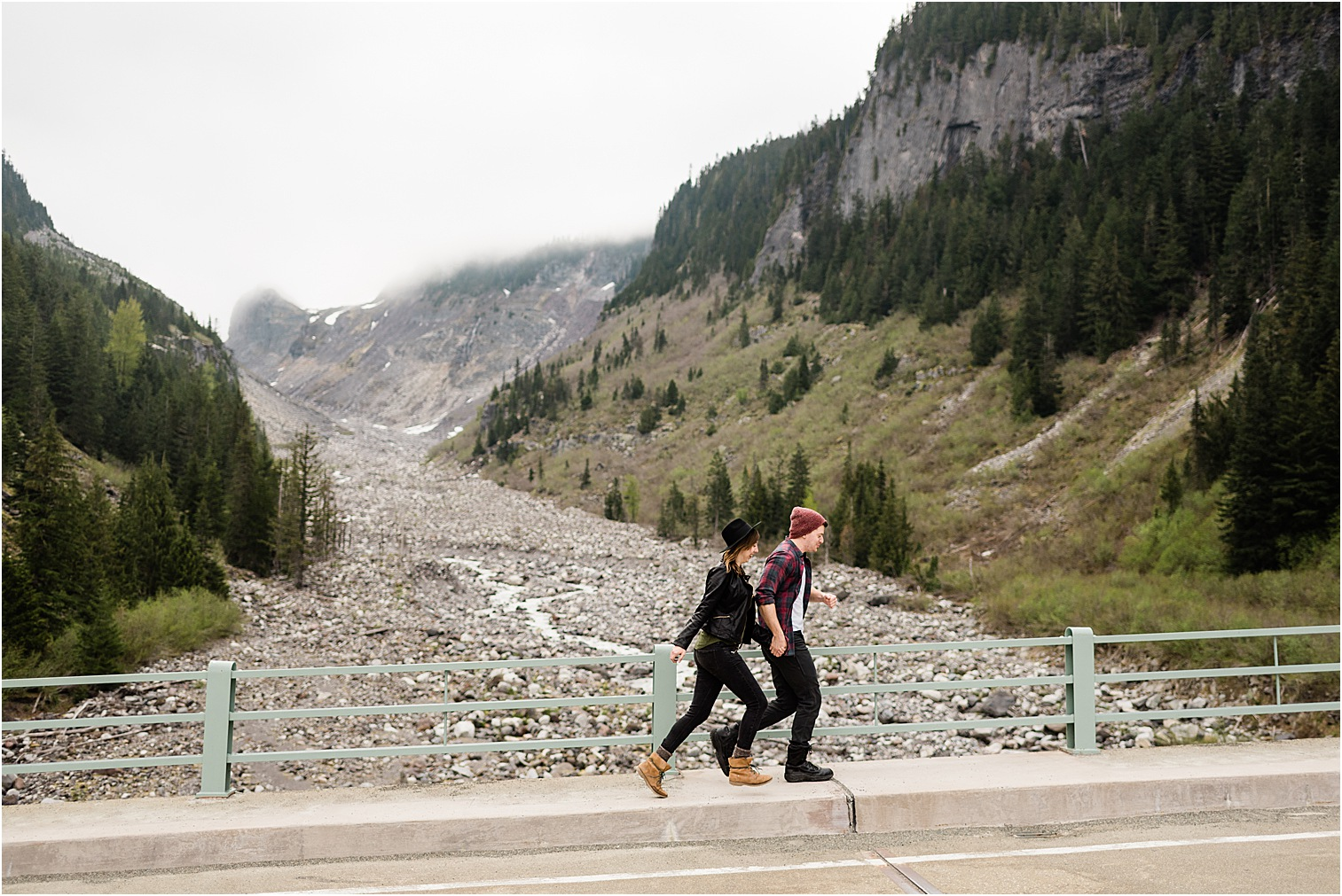 Couple crossing a mountain road bridge. Image by Forthright Photo, Mt Rainier Photographer