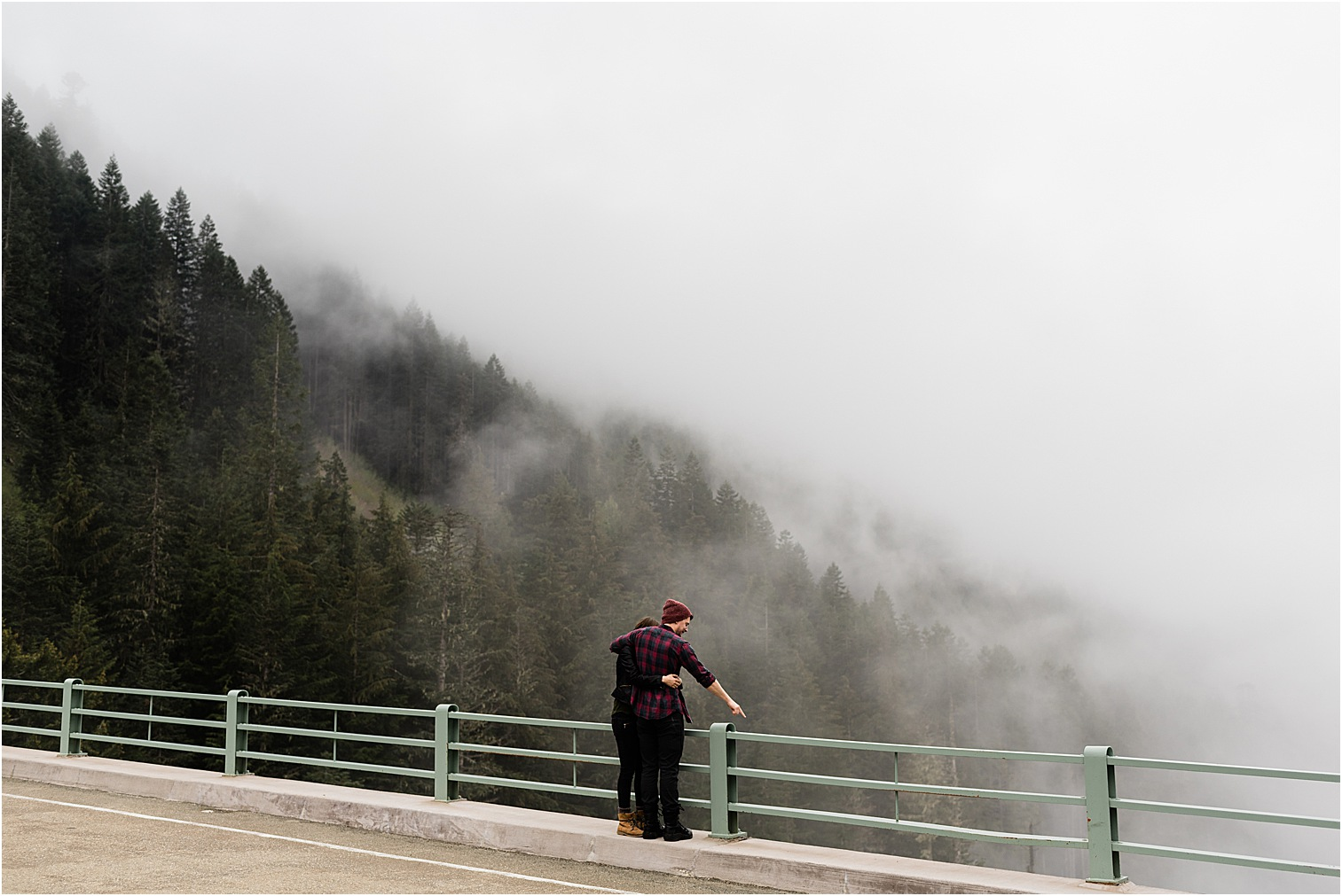 Couple on a mountain road bridge. Image by Forthright Photo, Mt Rainier Photographer