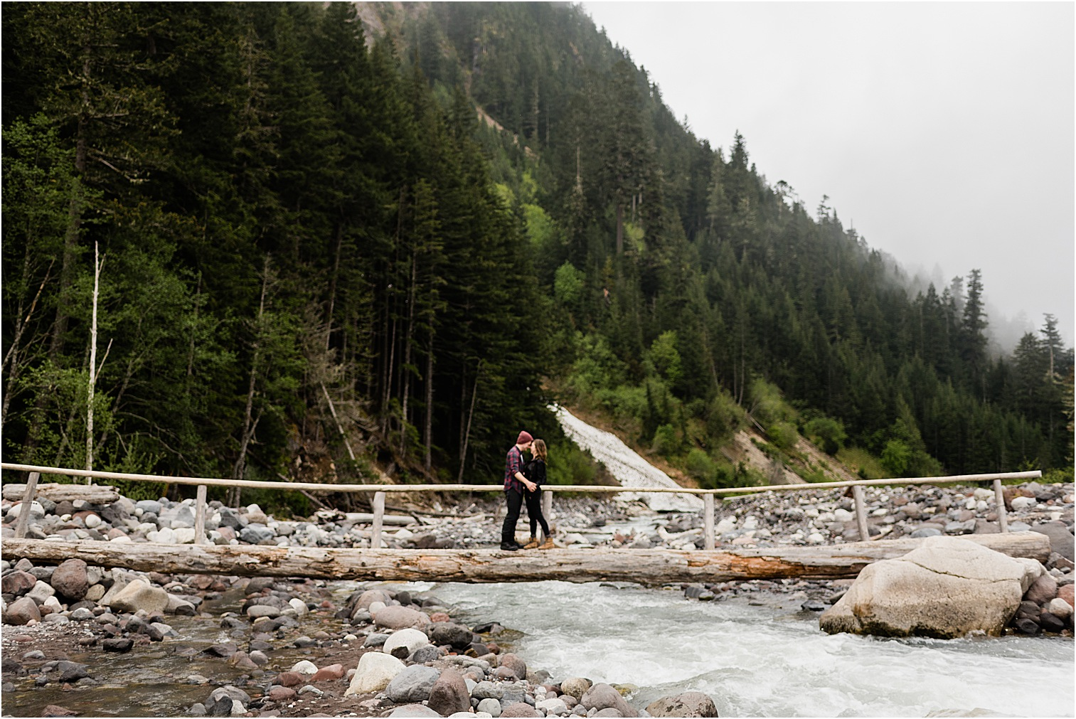 Couple on a log bridge in Rainier NP. Image by Forthright Photo, Mt Rainier Photographer