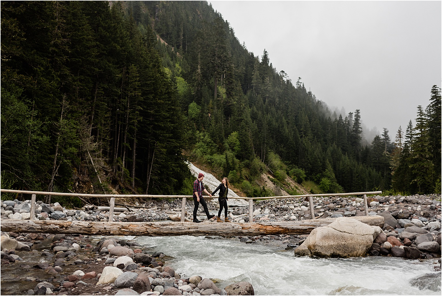 Couple crossing a log bridge in Mt Rainier NP. Image by Forthright Photo, Mt Rainier Photographer
