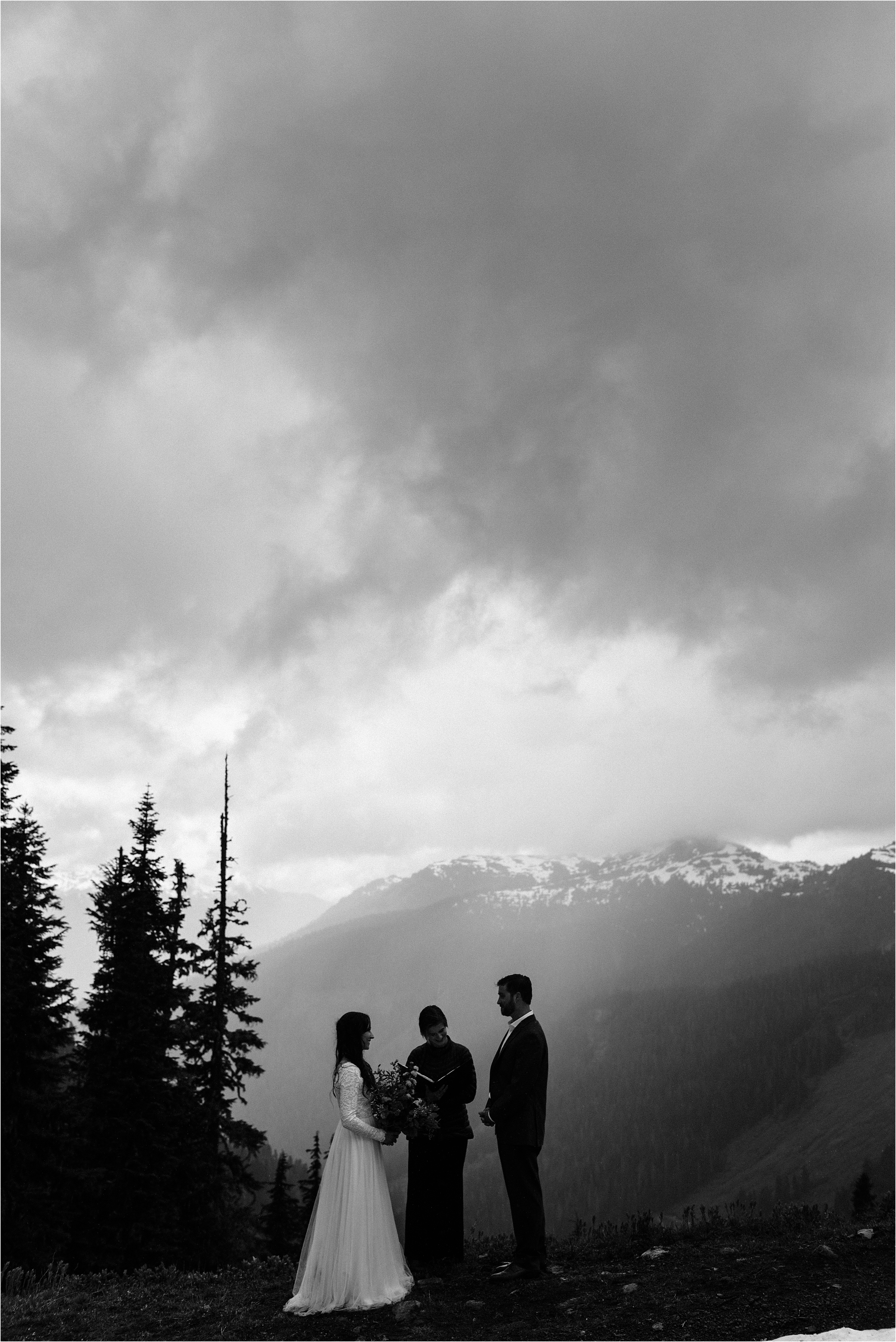 A rainy elopement Ceremony in the mountains surrounding Mt. Baker. Image by Forthright Photo, Seattle Elopement Photographers.