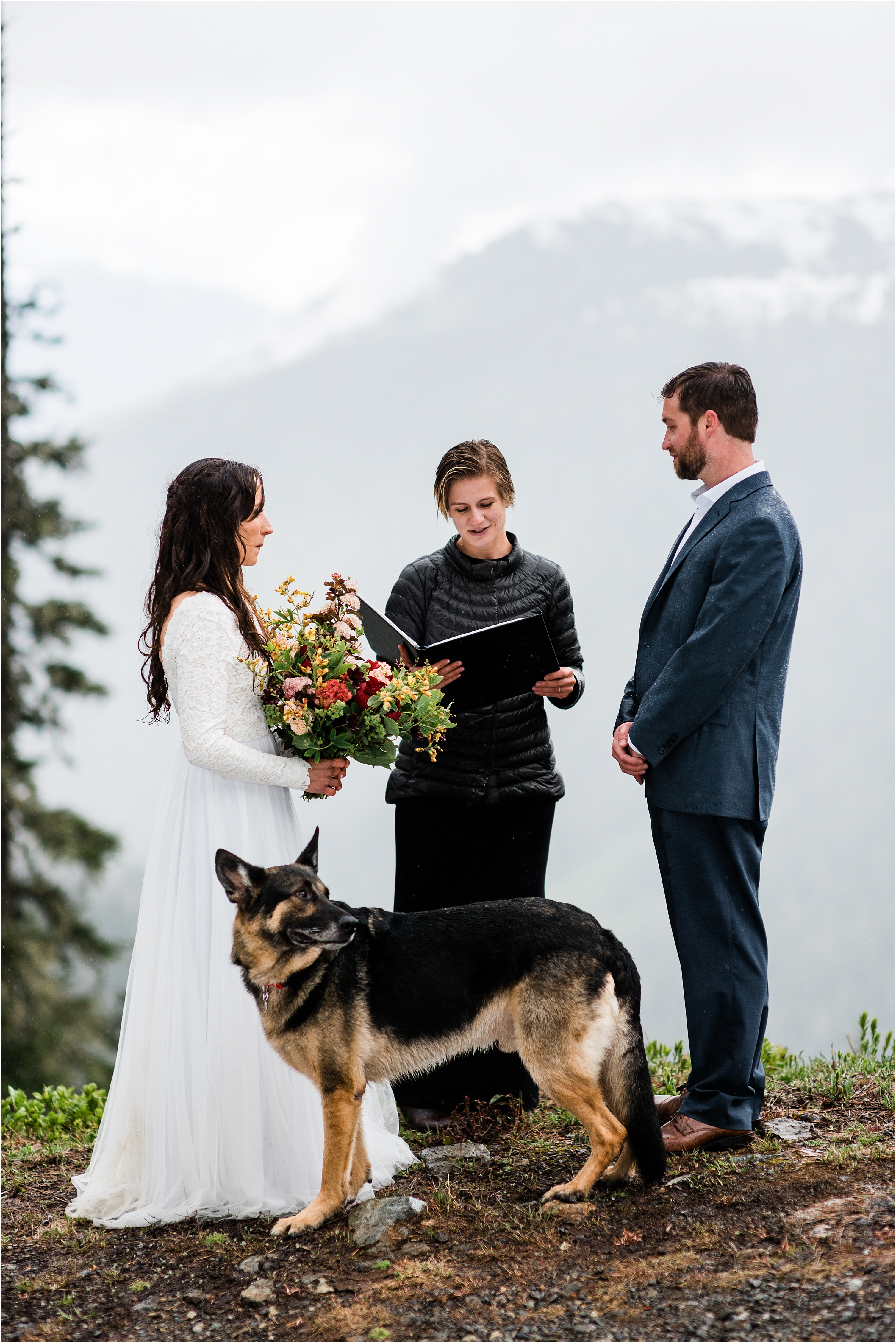 Christina & Tanner's dog stands watch during their elopement ceremony in the North Cascades. Image by Forthright Photo, PNW Wedding Photographers.