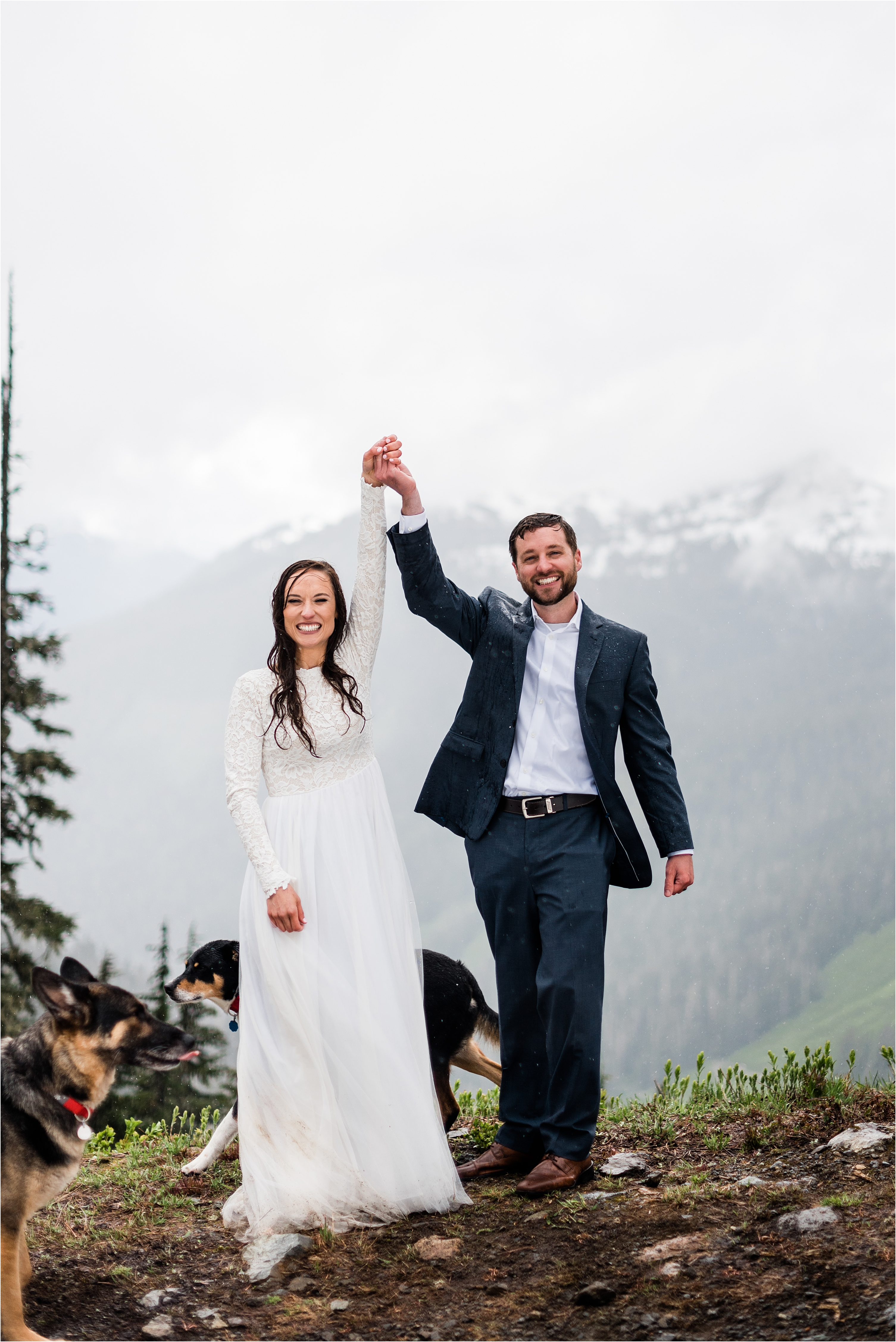 Christina & Tanner celebrating their elopement ceremony, surrounded by the North Cascade mountains and their two dogs. Image by Forthright Photo, Seattle Elopement Photographers.