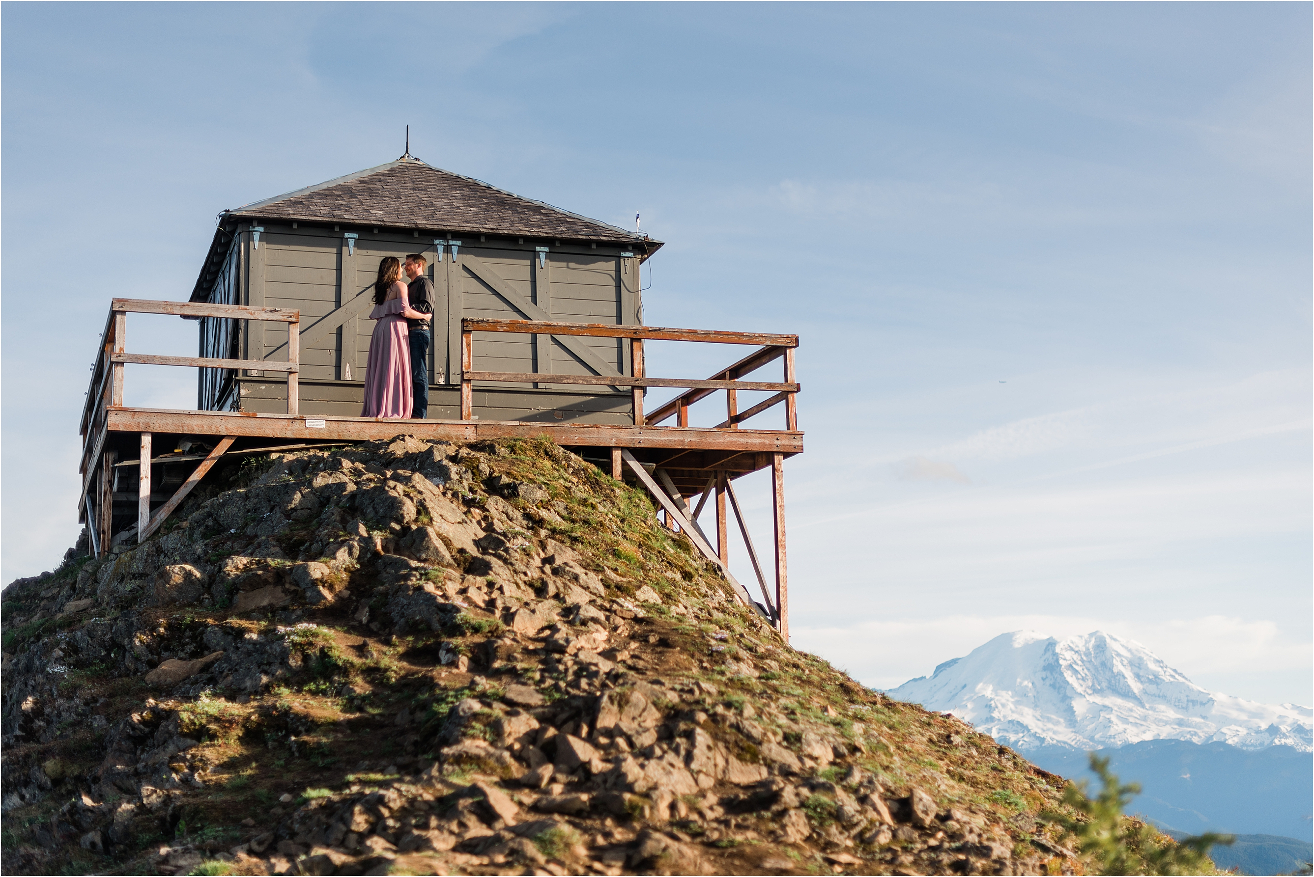 Engagement session at a Washington fire look-out with views of Mt Rainier. Image by Forthright Photo, Seattle Photographers.