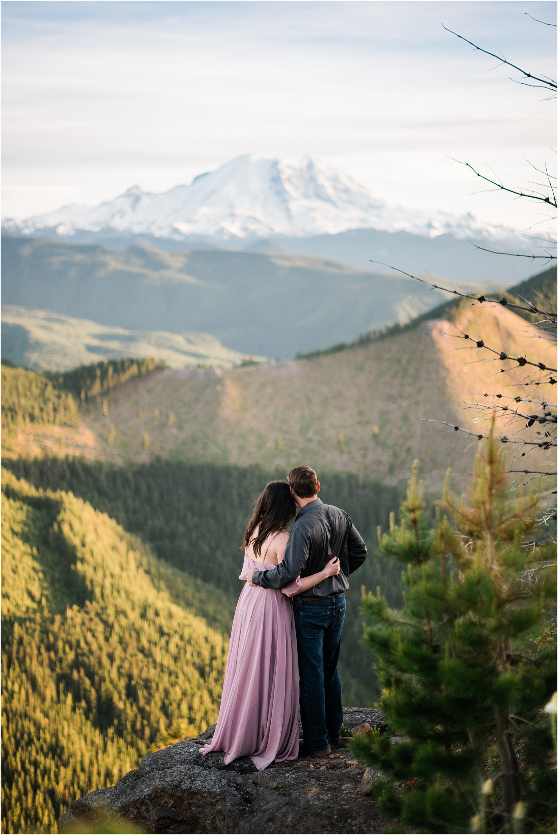 Adventure engagement session at a fire lookout with views of Mt Rainier. Image by Forthright Photo, Seattle Wedding Photographers.