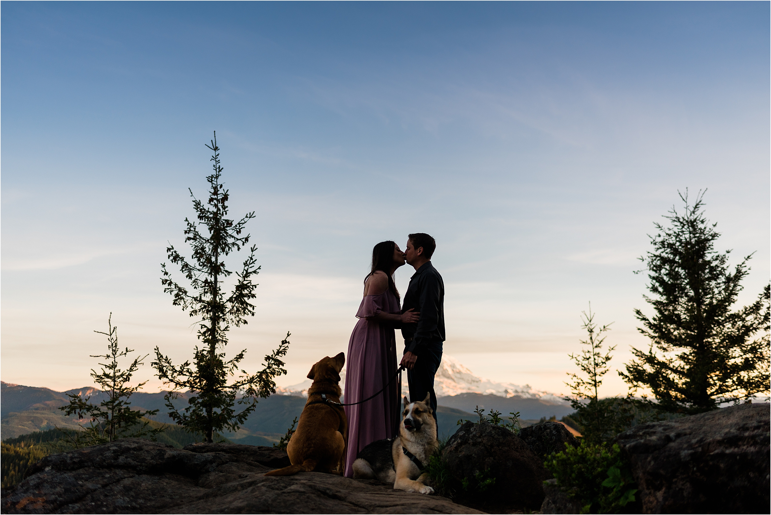 Haley & William and their two dogs. Adventure engagement session at a fire lookout with views of Mt Rainier. Image by Forthright Photo, Seattle Wedding Photographers.