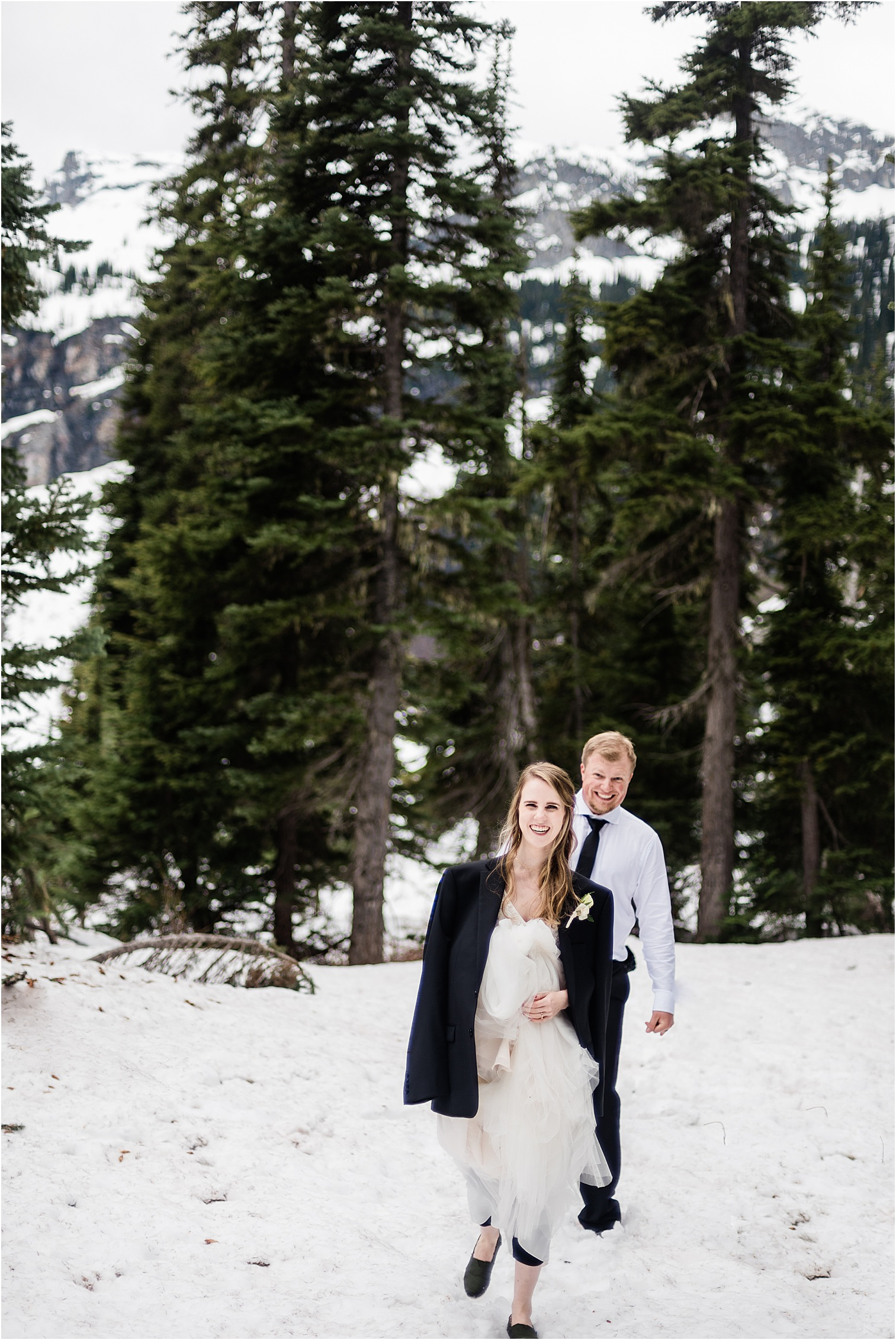 Hope & Steven hiking in their wedding clothes during their Adventure Wedding in the North Cascades. Image by Forthright Photo, Seattle Wedding & Elopement Photographers