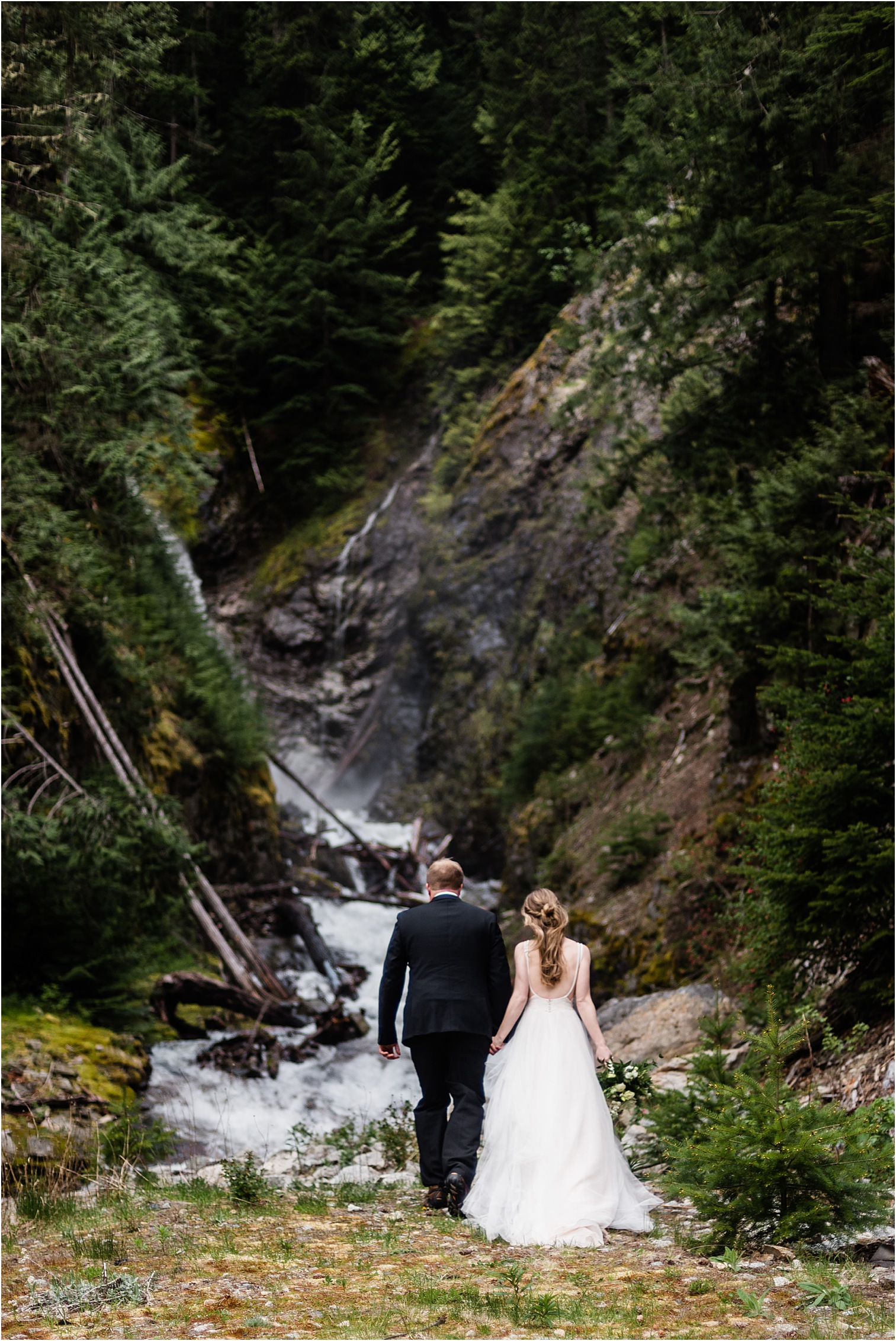 Hope & Steven at a roadside waterfall during their Adventure Wedding in the North Cascades. Image by Forthright Photo, Seattle Wedding & Elopement Photographers