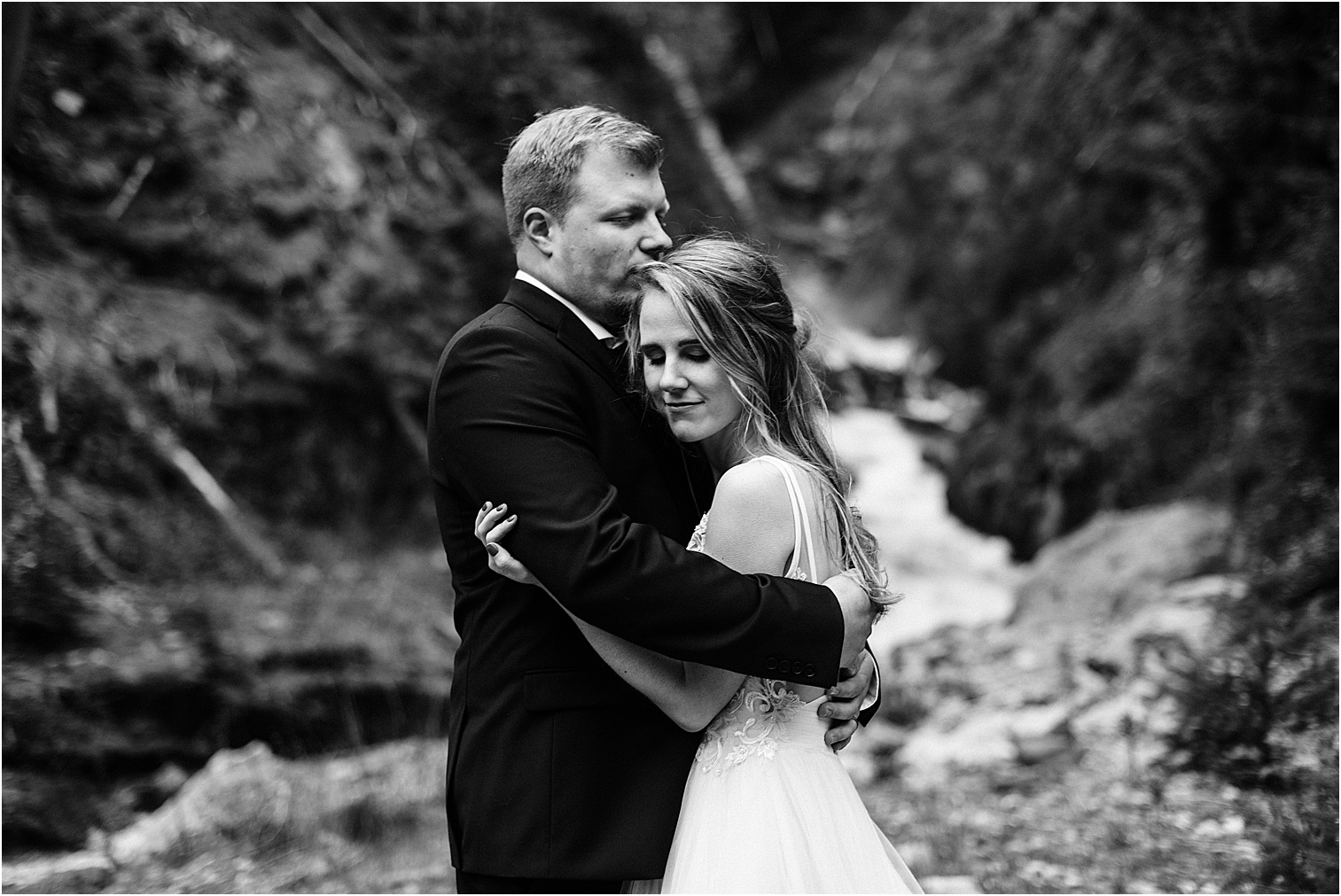 Hope & Steven share a quiet moment at a roadside waterfall during their Adventure Wedding in the North Cascades. Image by Forthright Photo, Seattle Wedding & Elopement Photographers