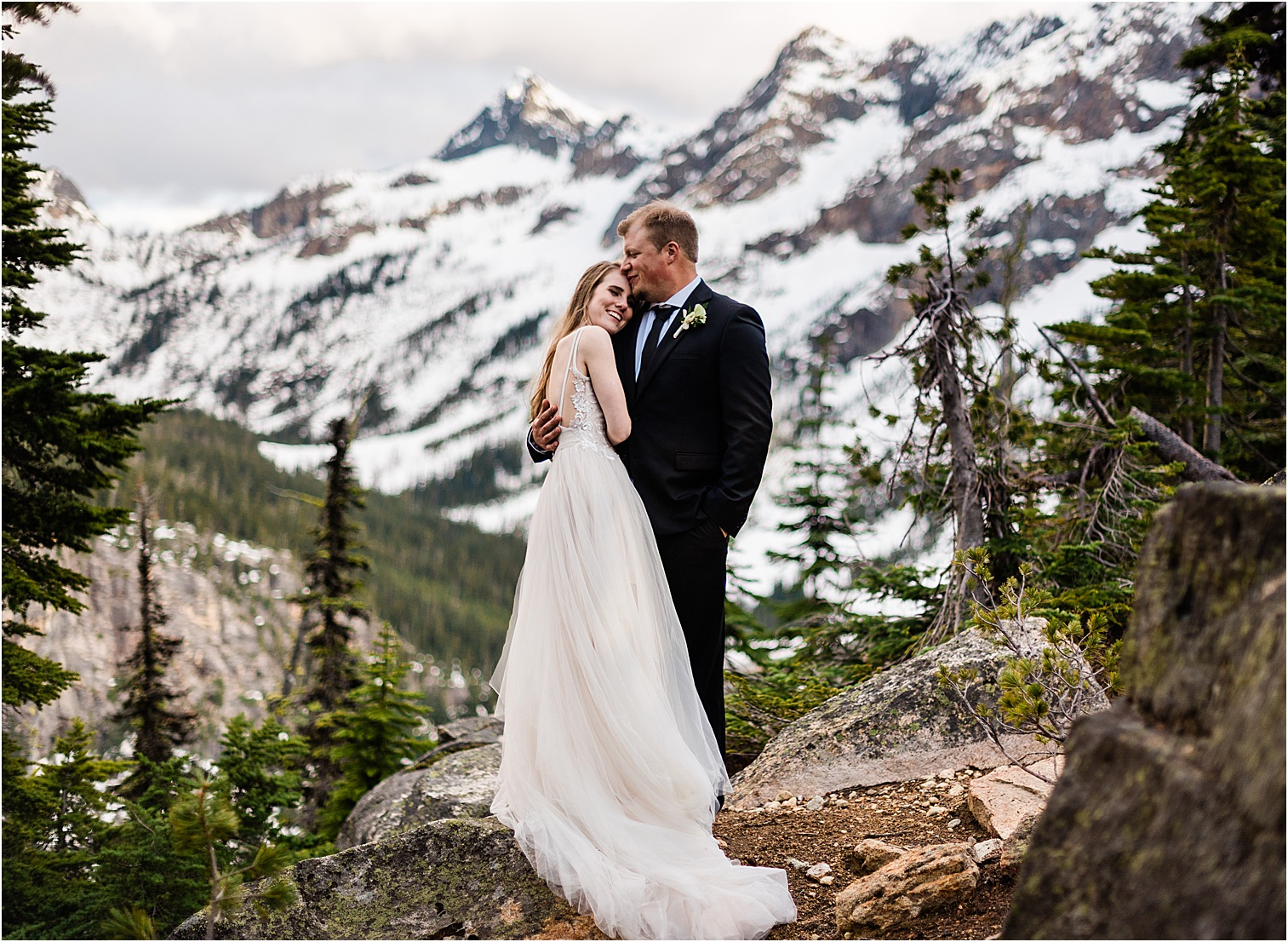 Hope & Steven enjoying a sunset dance at Washington Pass overlook during their Adventure Wedding in North Cascades National Park. Image by Forthright Photo, Seattle Wedding & Elopement Photographers