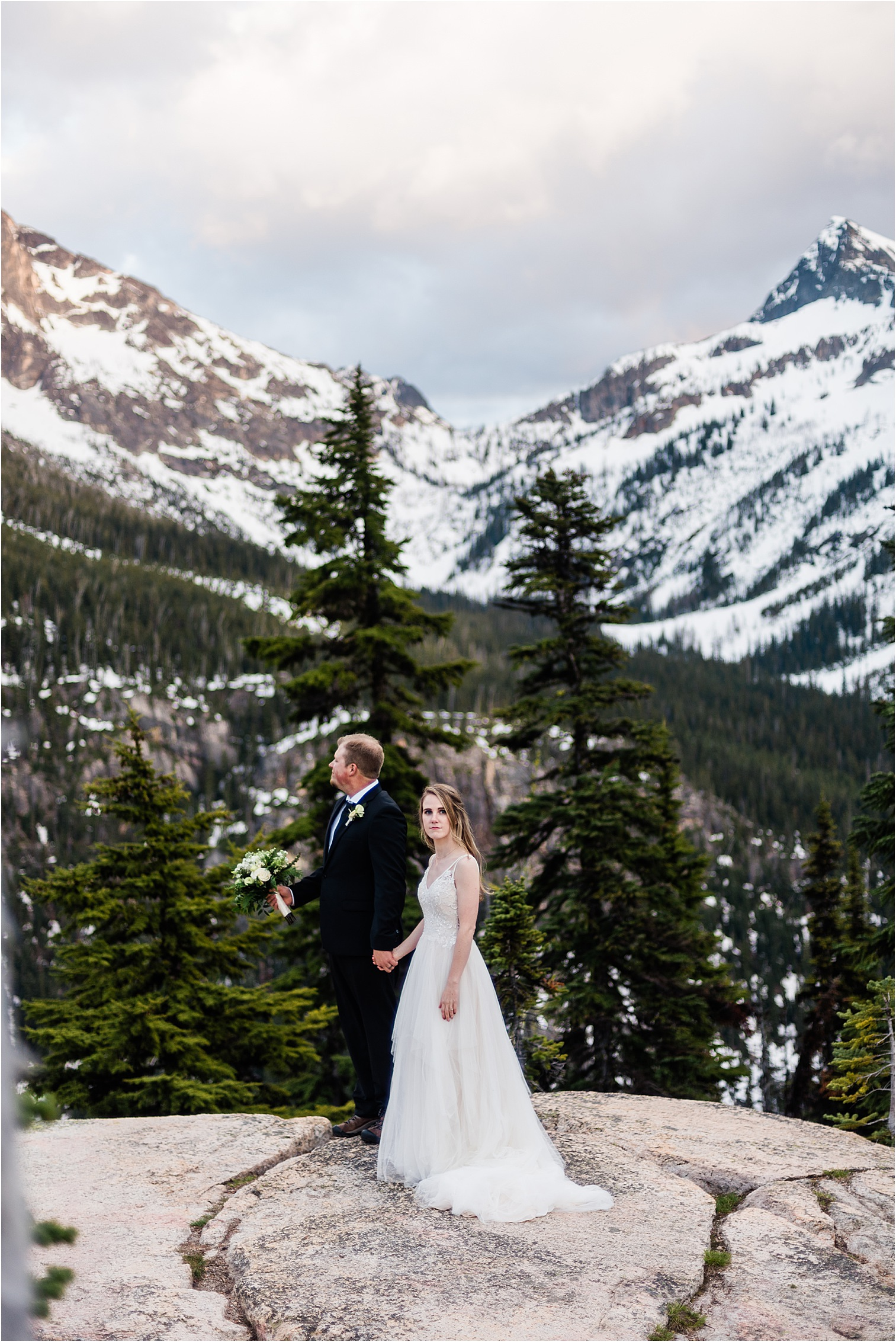 Hope & Steven enjoying Washington Pass overlook during their Adventure Wedding in North Cascades National Park. Image by Forthright Photo, Seattle Wedding & Elopement Photographers