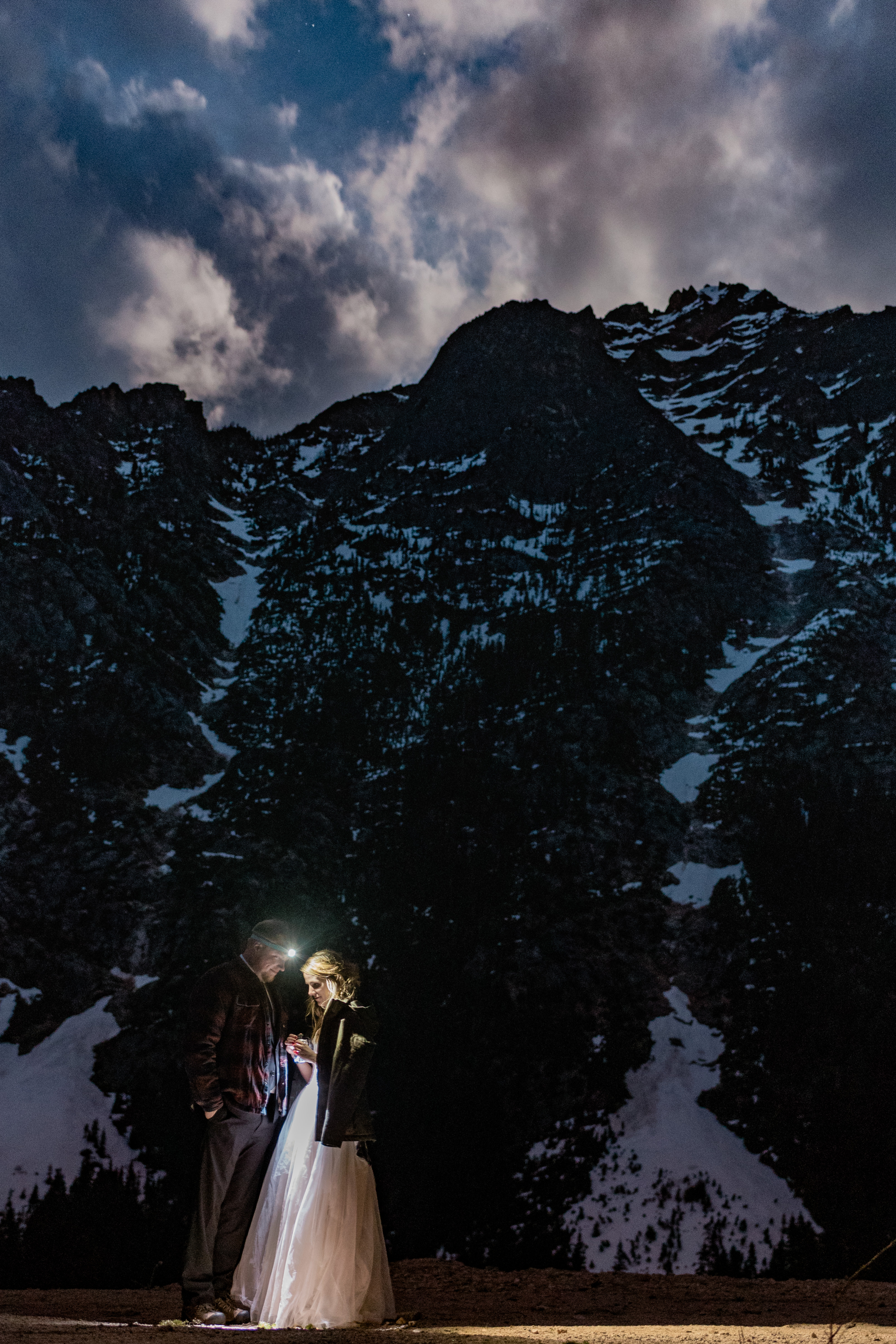 Hope & Steven with the night sky over Washington Pass in the North Cascades. Image by Forthright Photo, Seattle Wedding & Elopement Photographers