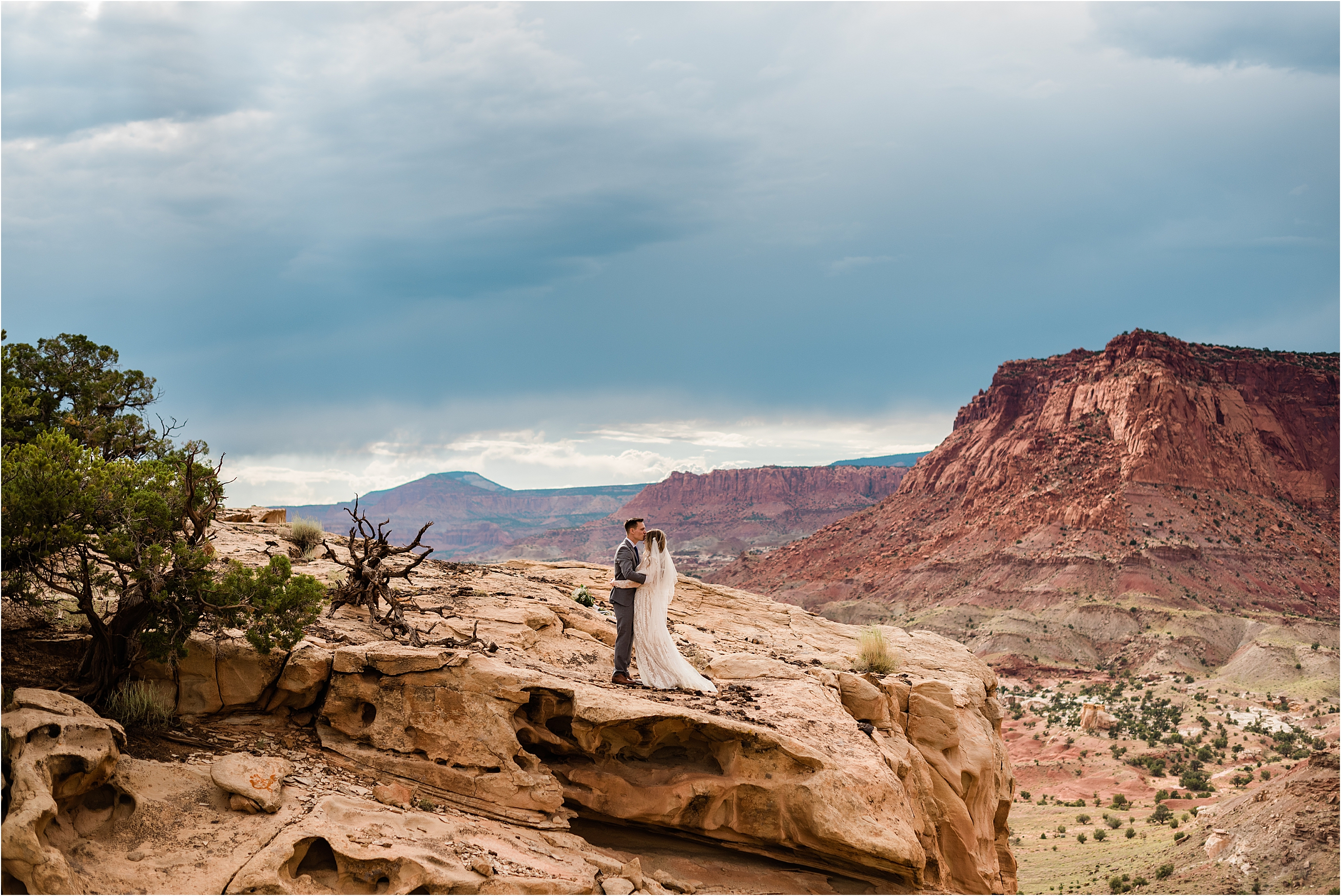 Overcast skies and storm clouds at Capitol Reef adventure wedding. Image by Forthright Photo, wedding and elopement photographers
