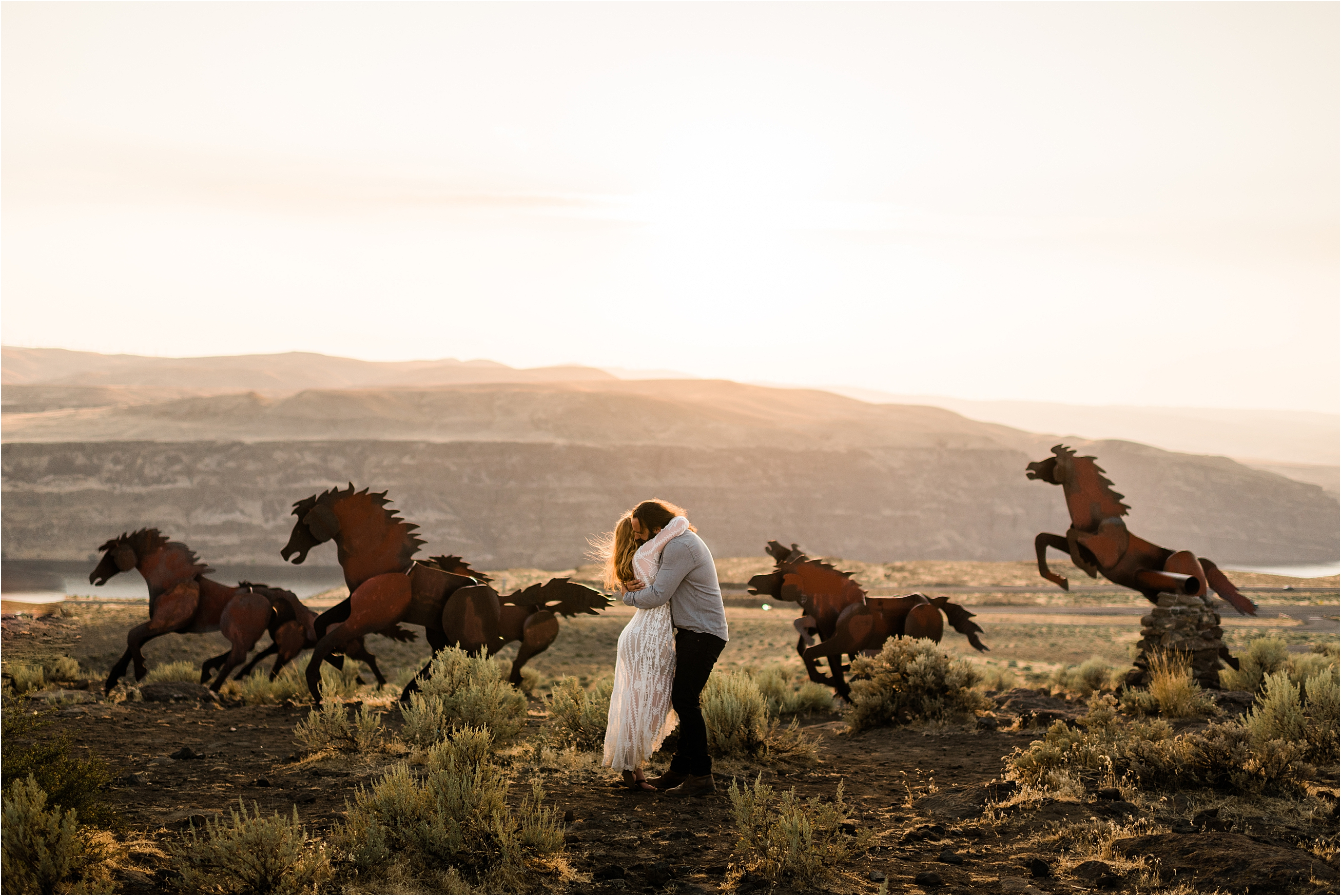 Caitlin & Tarnell at the Wild Horse Monument in Vantage, Washington. Elopement by Forthright Photo.