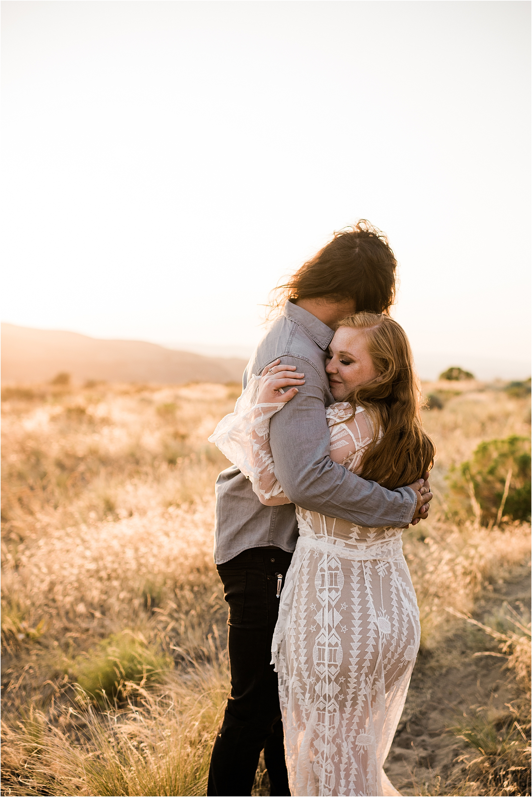 Caitlin & Tarnell walking along the central washington scrublands in wedding attire. Wild Horse Monument Elopement Inspiration by Forthright Photo.