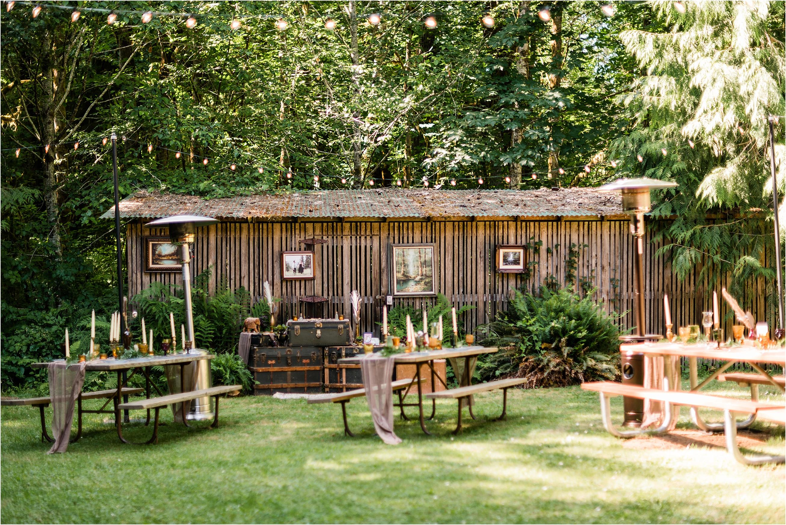 Reception Decor at Cassy & Viva's bohemian Oregon destination wedding at Camp Lane. Image by Forthright Photo.