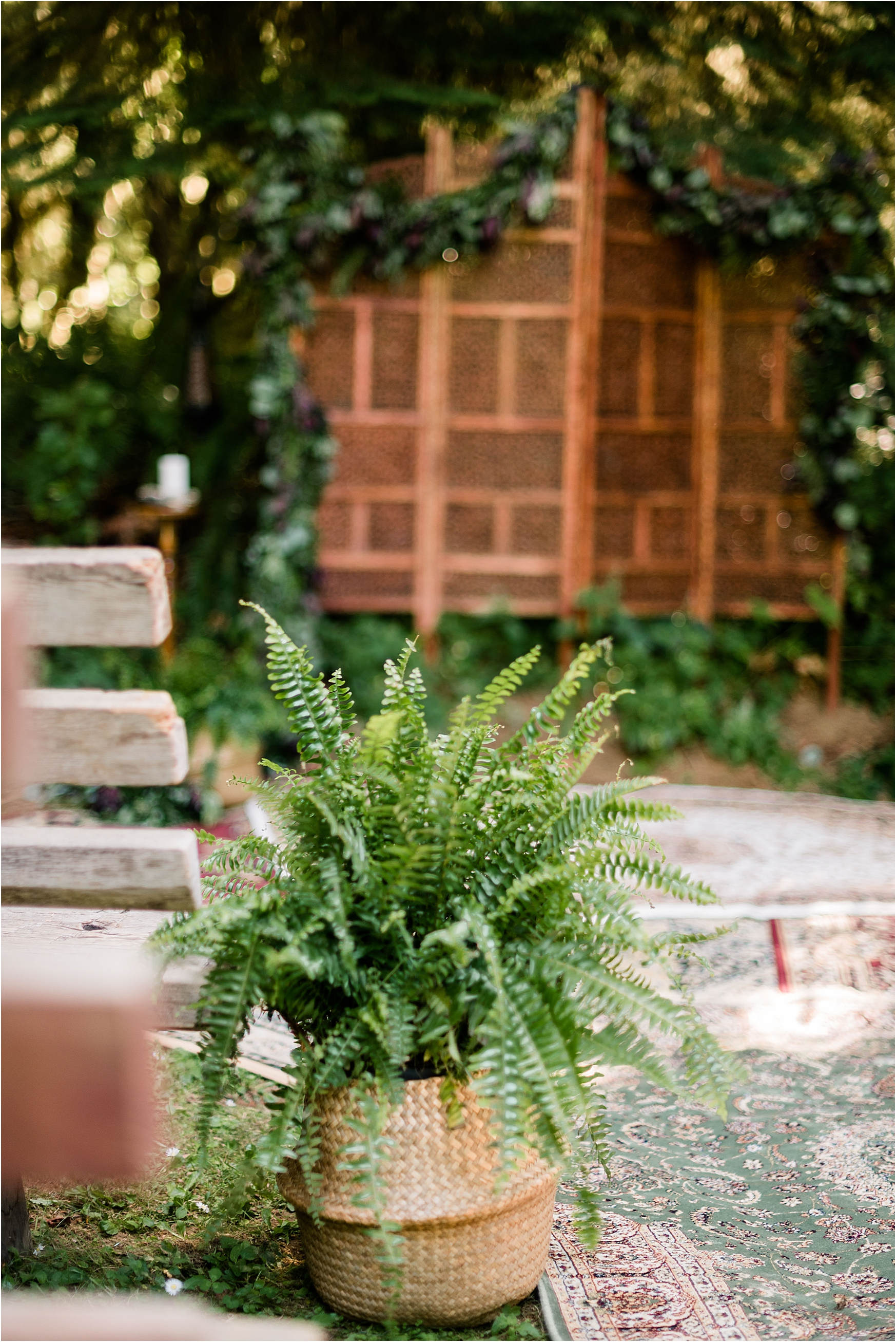 Baskets of ferns as ceremony decor at Cassy & Viva's bohemian Oregon destination wedding at Camp Lane. Image by Forthright Photo.