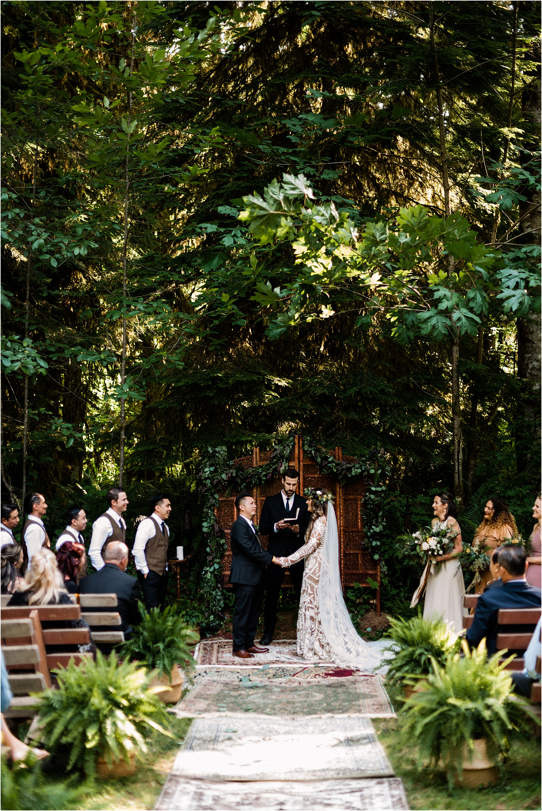 Ceremony at Cassy & Viva's bohemian Oregon destination wedding at Camp Lane. Image by Forthright Photo.
