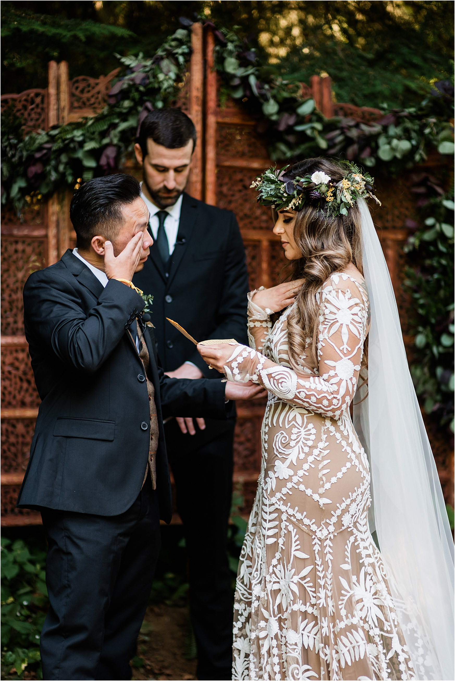 Emotional vow exchange at Cassy & Viva's bohemian Oregon destination wedding at Camp Lane. Image by Forthright Photo.