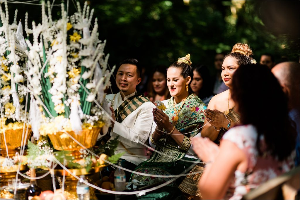 Cassy & Viva at their first ceremony, a traditional Laotian wedding ceremony.