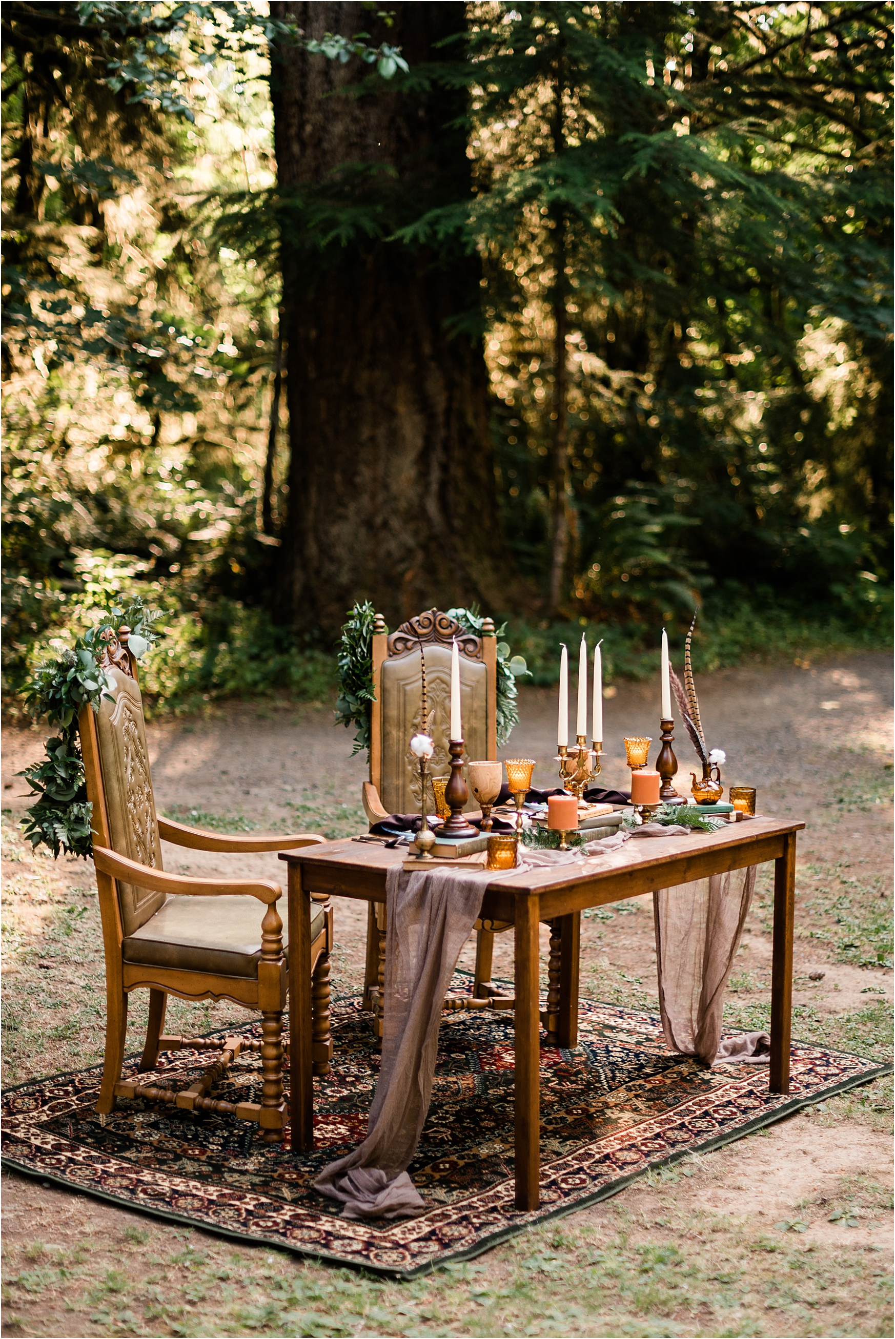 Sweetheart table at Cassy & Viva's bohemian Oregon destination wedding at Camp Lane. Image by Forthright Photo.