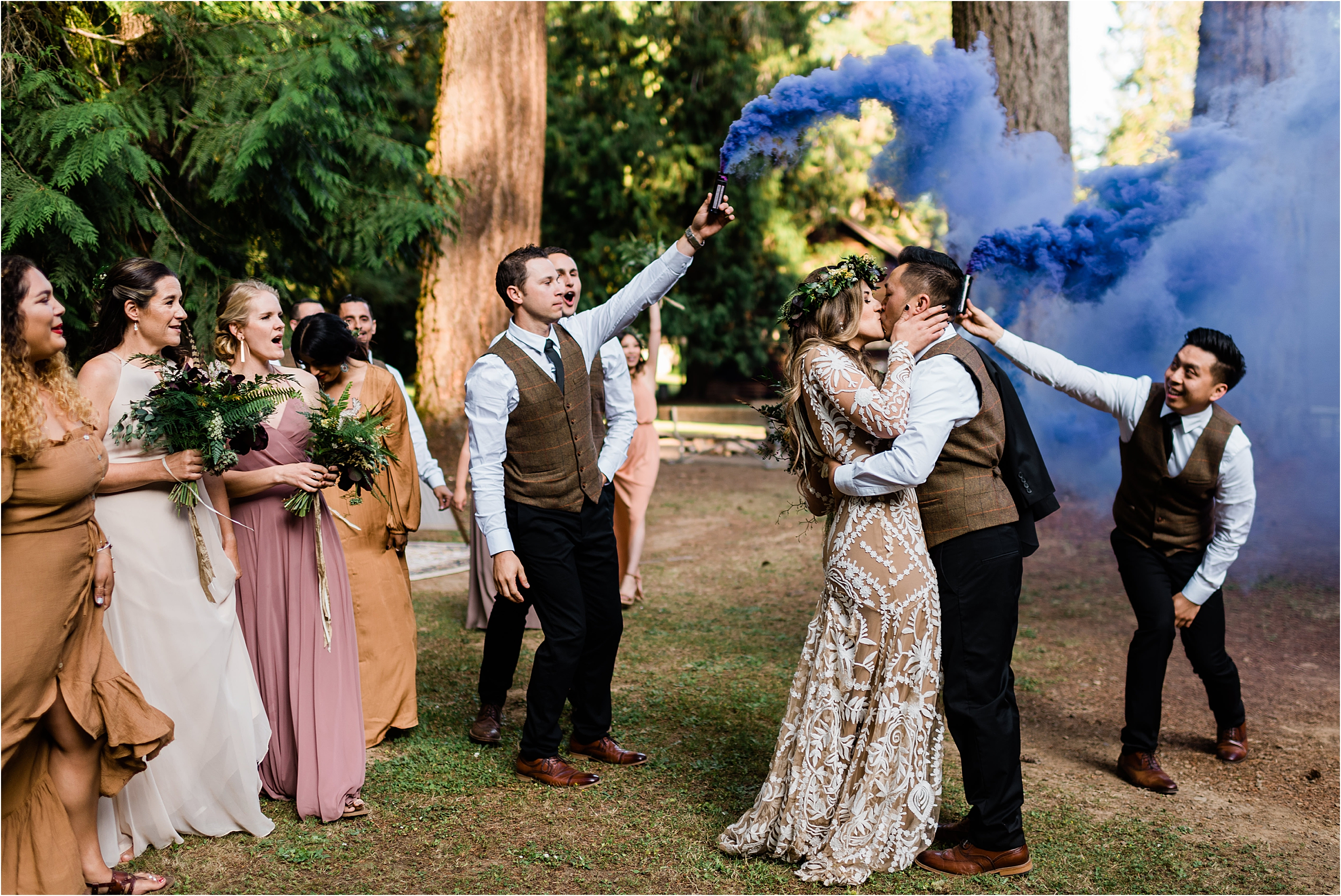 Purple smoke bomb Bride and Groom grand entrance at Cassy & Viva's bohemian Oregon destination wedding at Camp Lane. Image by Forthright Photo.