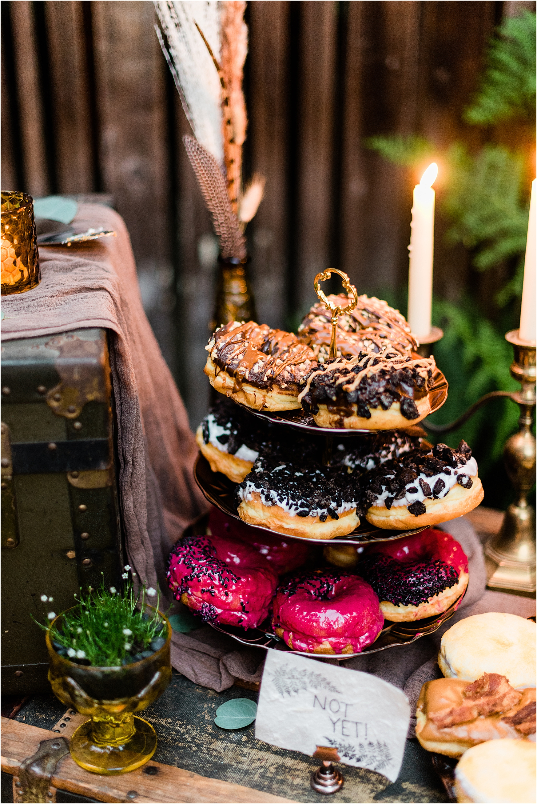 Voodoo Doughnuts at Cassy & Viva's bohemian Oregon destination wedding at Camp Lane. Image by Forthright Photo.